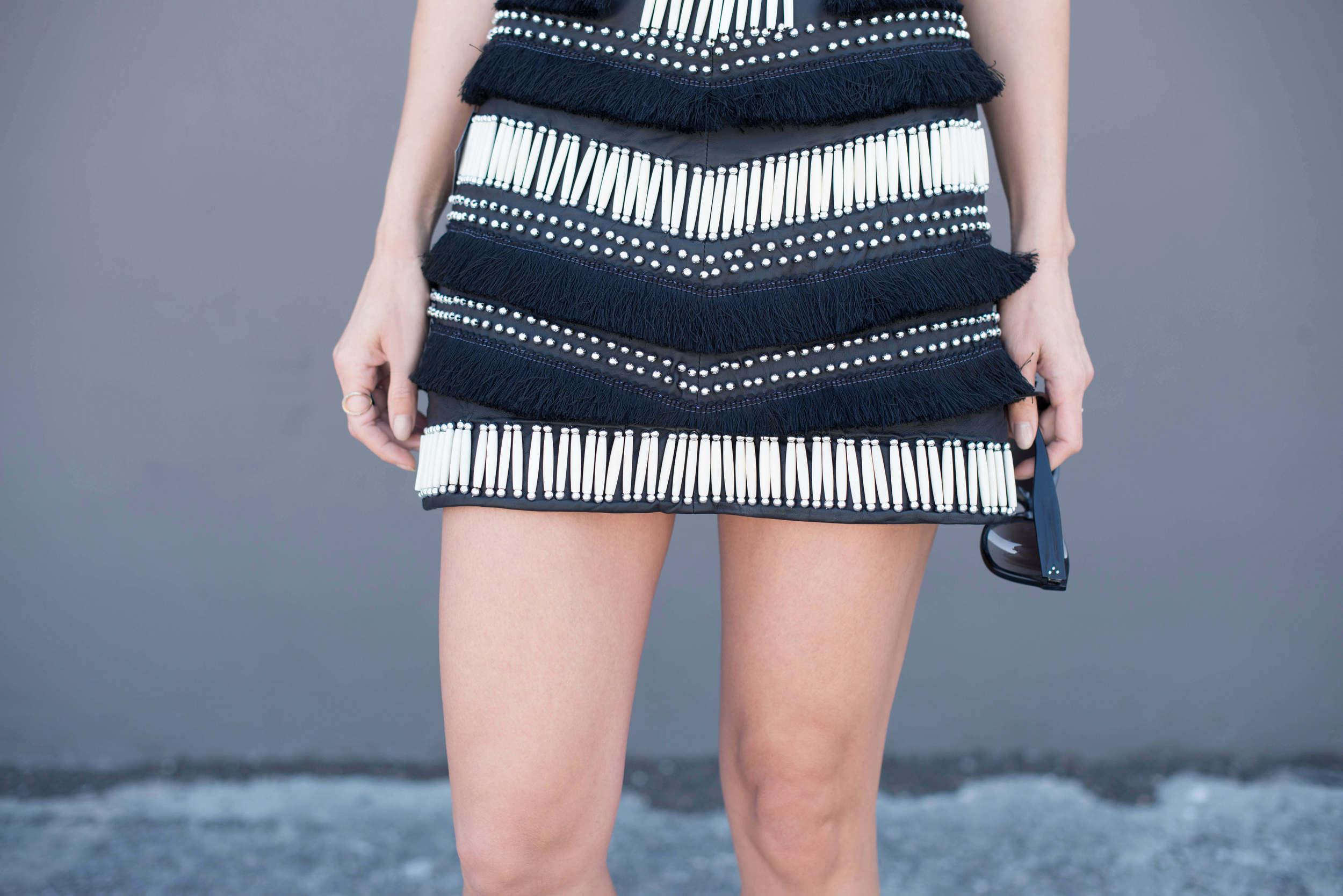 Fringe and bone mini skirt and Céline sunglasses