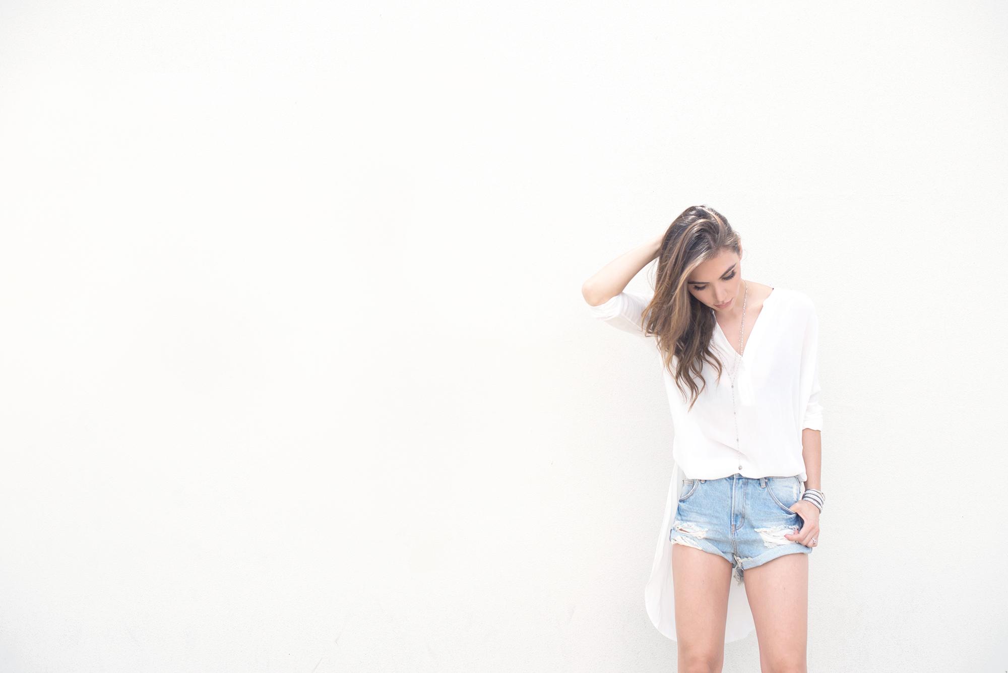 White blouse and denim shorts