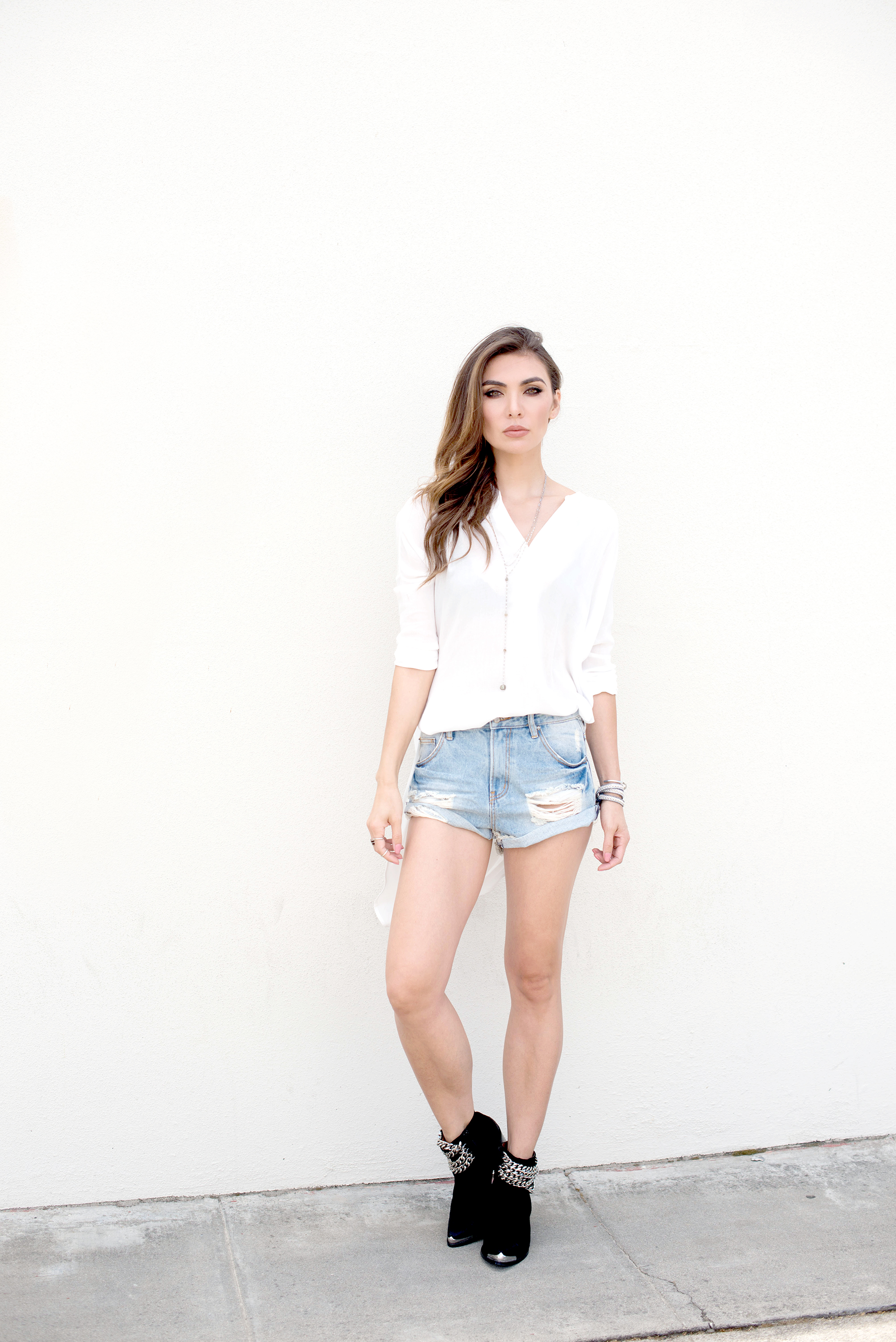 White blouse, denim shorts and ankle boots