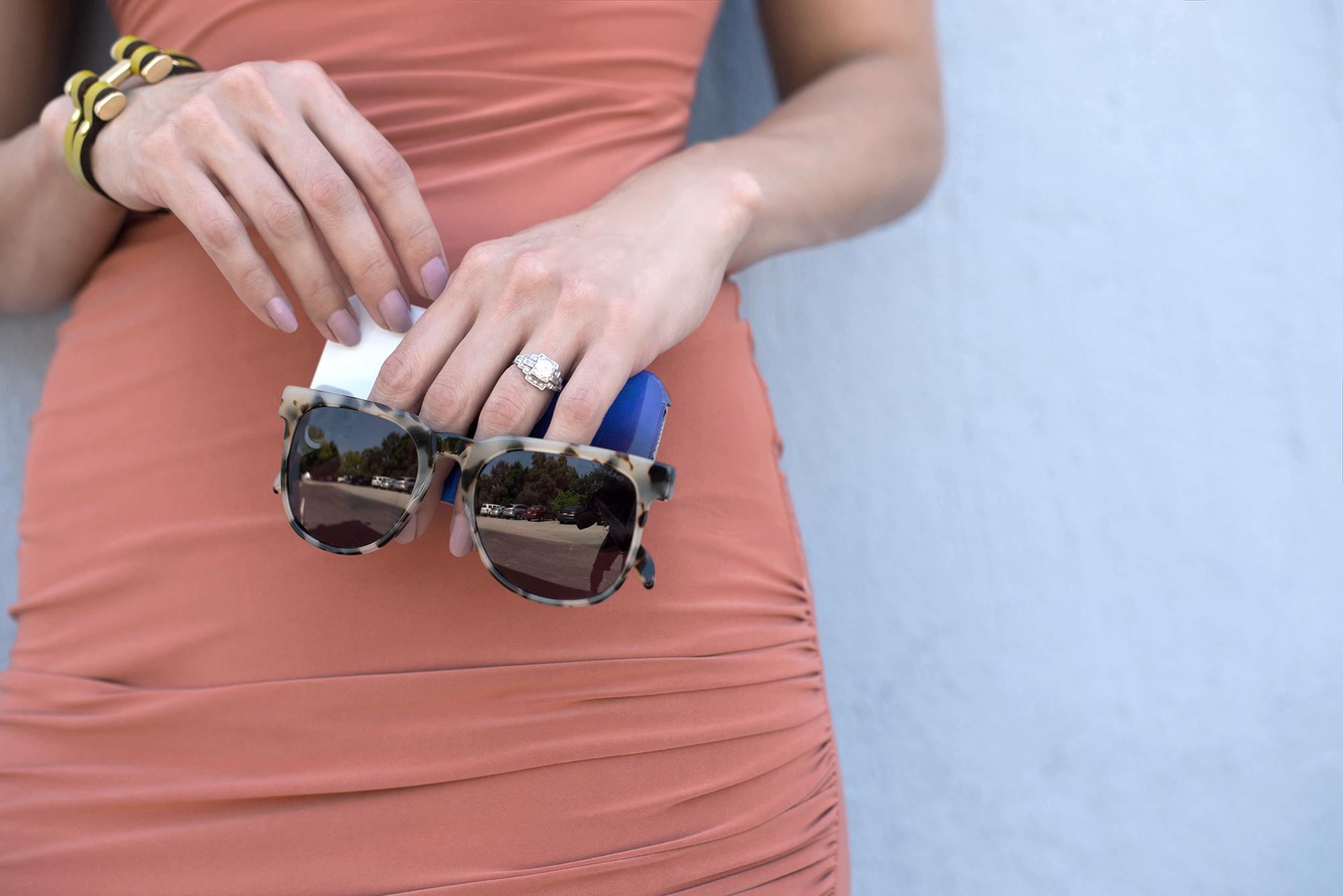 Julia Kostreva iPhone case and Komono sunglasses detail accessories shot