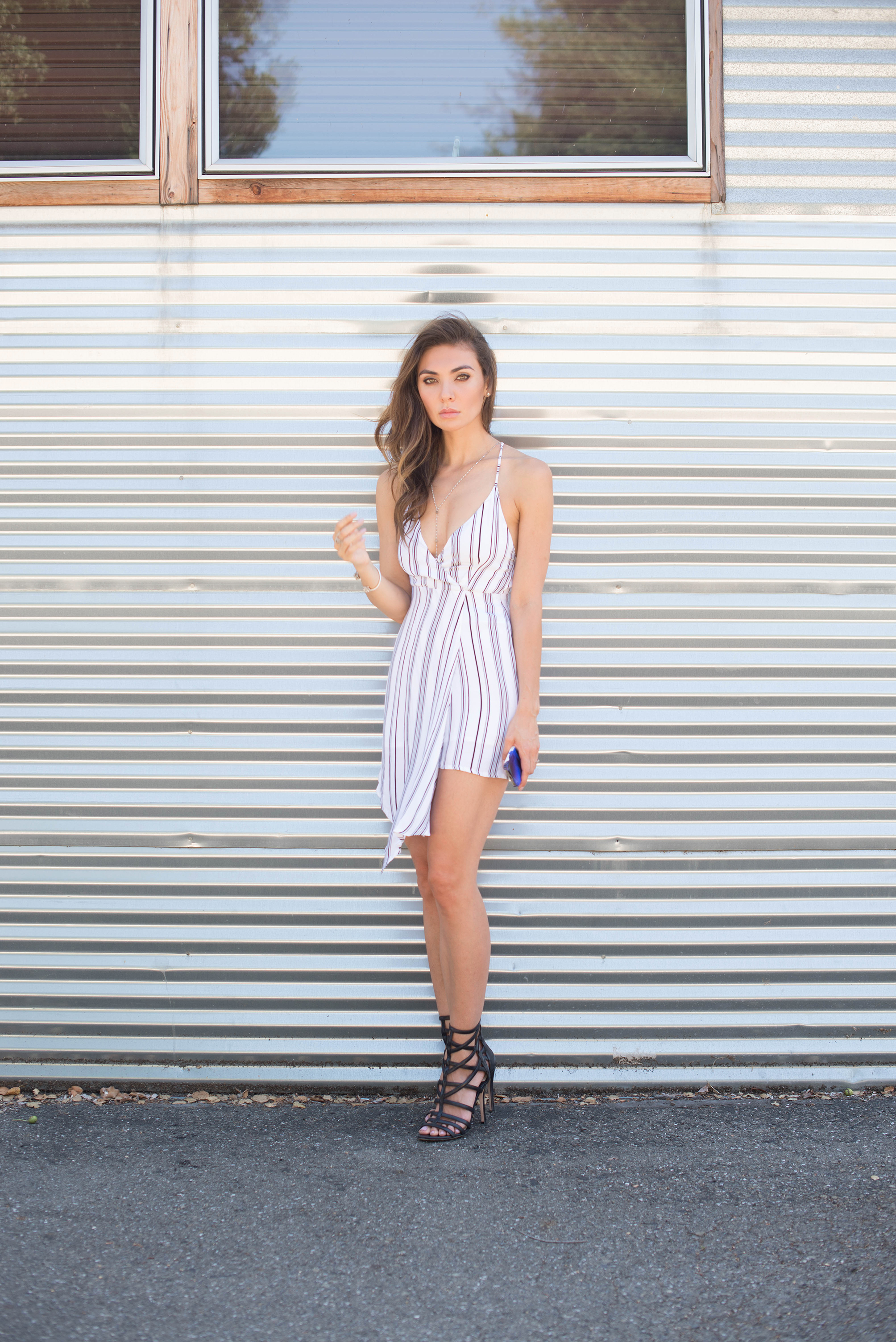 Asymmetric striped dress and strappy heels