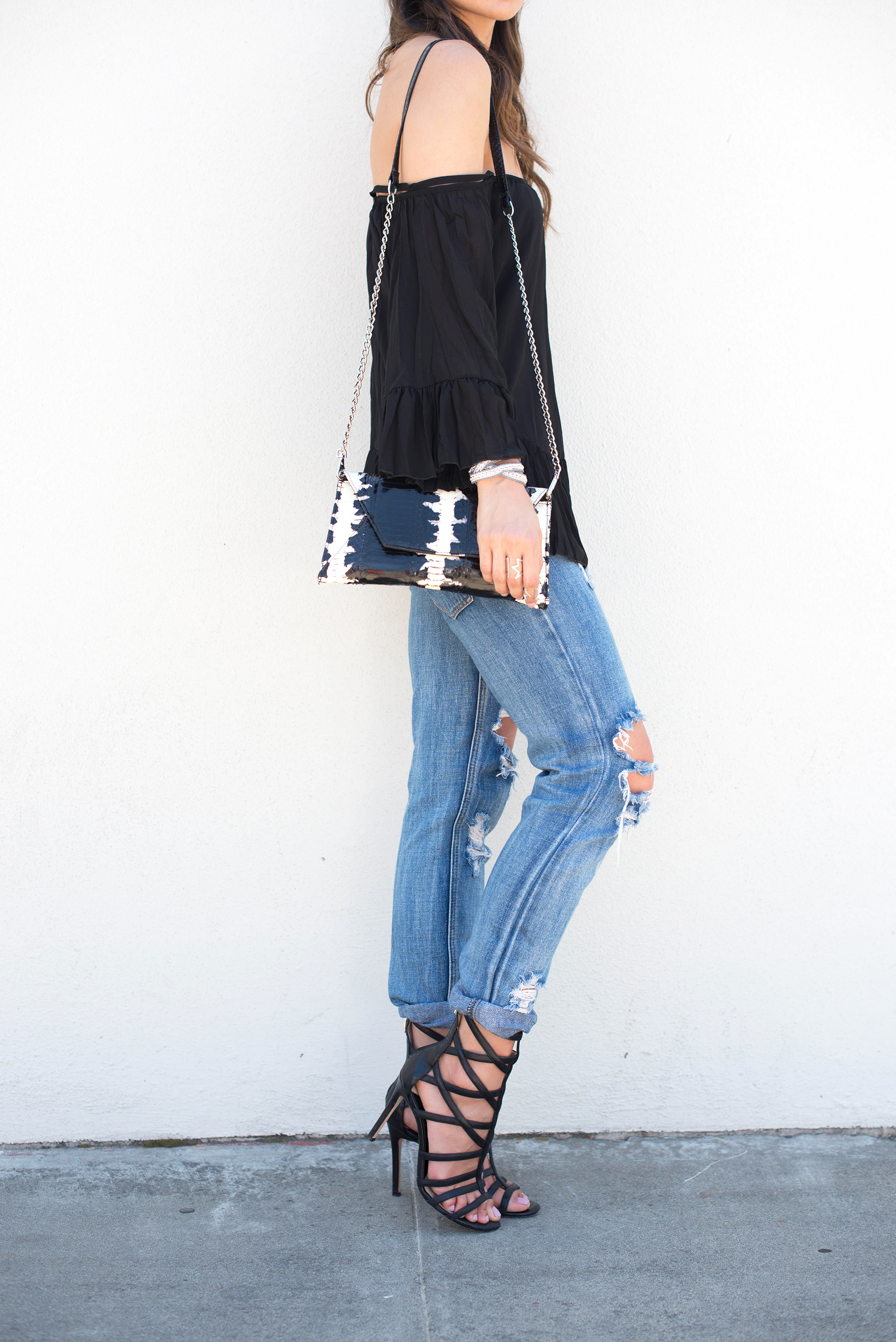Off the shoulder Bardot Top, snakeskin clutch, and One Teaspoon Awesome Baggies jeans