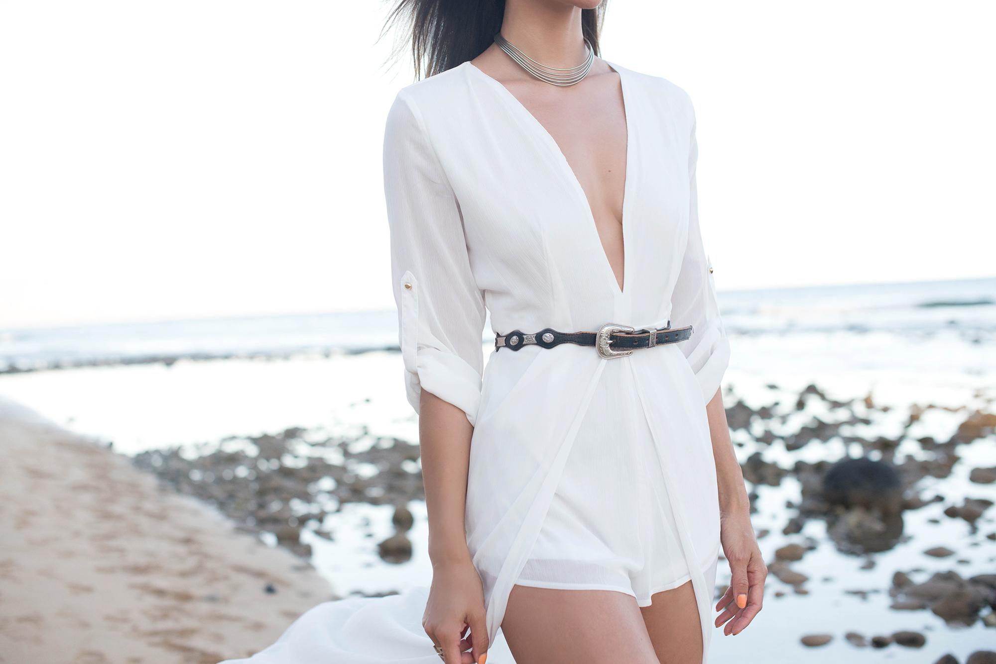 white romper by the beach.