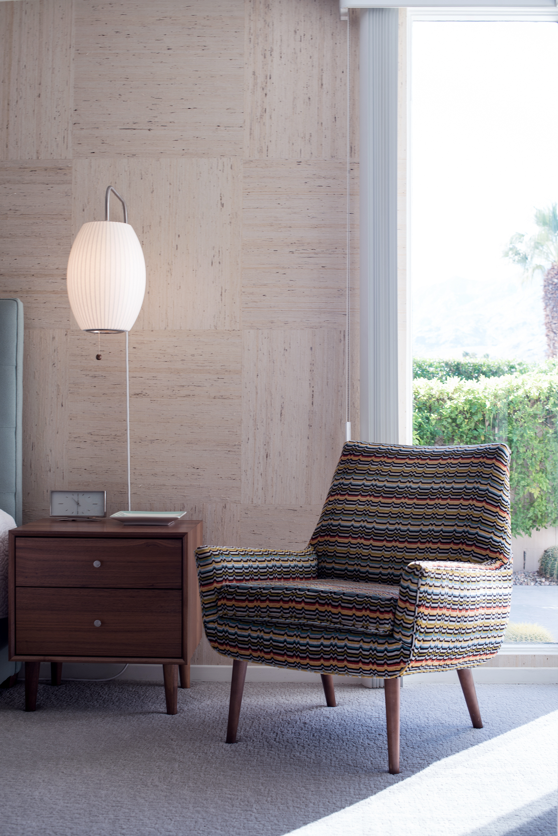 That table clock, lamp, and Missoni-inspired chair is giving me life, not to mention the wallpaper is fully on my wishlist.