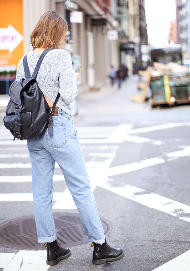 Modernize your mom jeans with a cropped sweater and lots of leather.