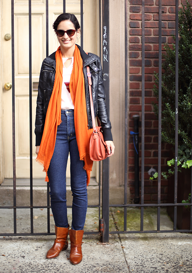 Just a bright bag and scarf might be enough to do the trick, and perhaps a colorful geometric necklace for the office. (Photo of Ana)
