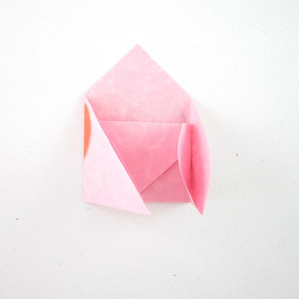 5. Insert left corner into right corner flap --->