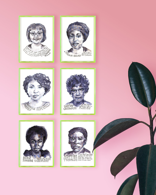 Vertical wall grouping of six black and white watercolor and ink portraits in neon lime green frames against a light pink wall with a rubber plant in the bottom right corner. Portraits are of Anita Hill, Ilhan Omar, Ayanna Pressley, Shirley Chisholm, Nina Simone, and Harriet Tubman.
