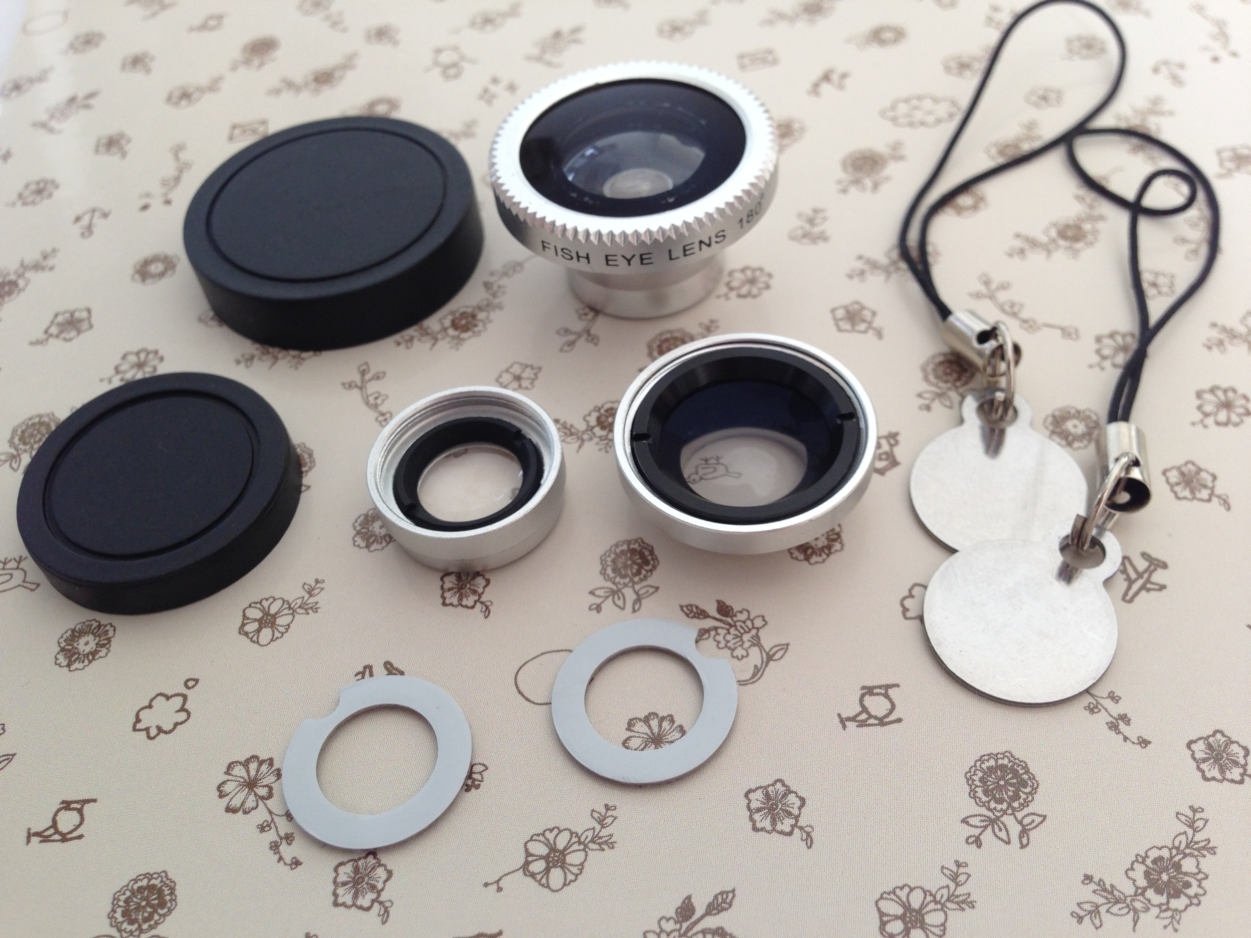 This is what you get: 3 lenses: wide angle, macro and fish eye (macro lens can be detached from wide-angle), 2 lens covers, 6 detachable magnetic rings and 2 magnetic key chains.