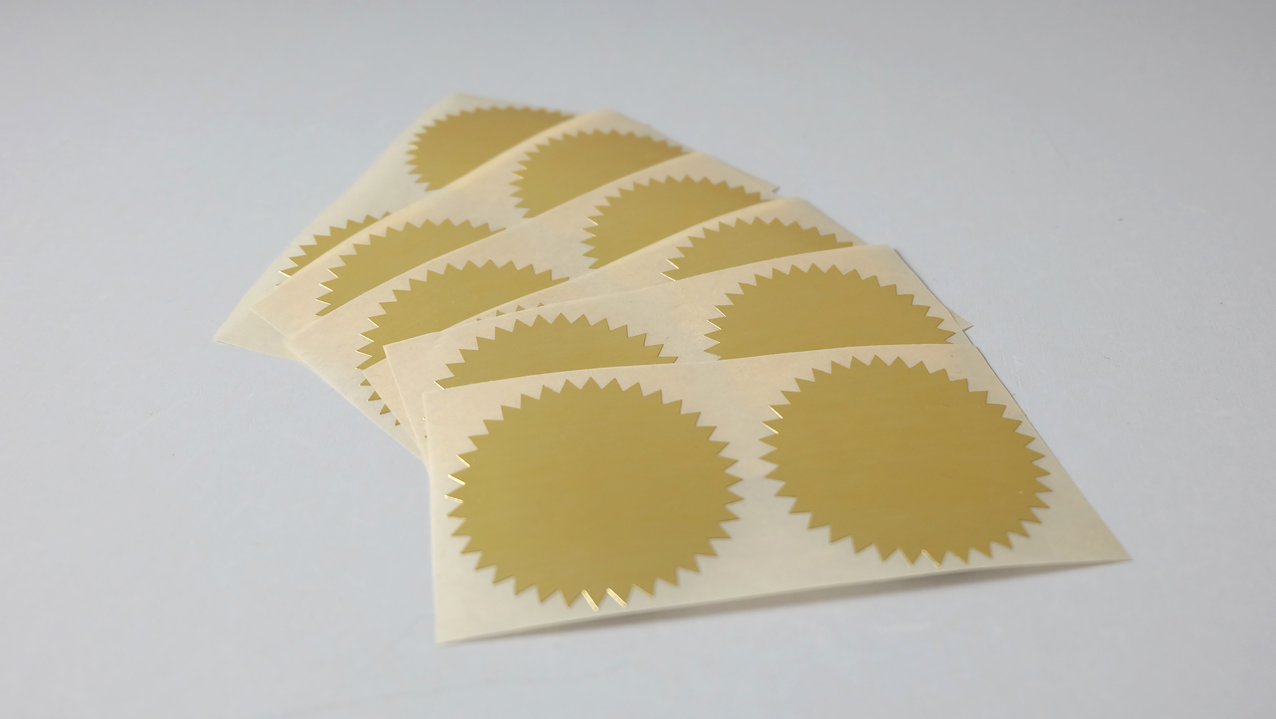 Starbust etiket goud €1,00 per 12 stuks.