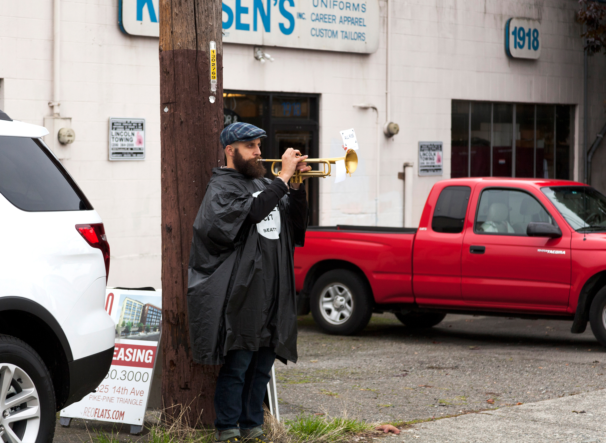 """Craig Shepard's """"Trumpet City"""" situated twenty-three trumpets surrounding the ALL RISE campus for an experiential rush-hour performance."""