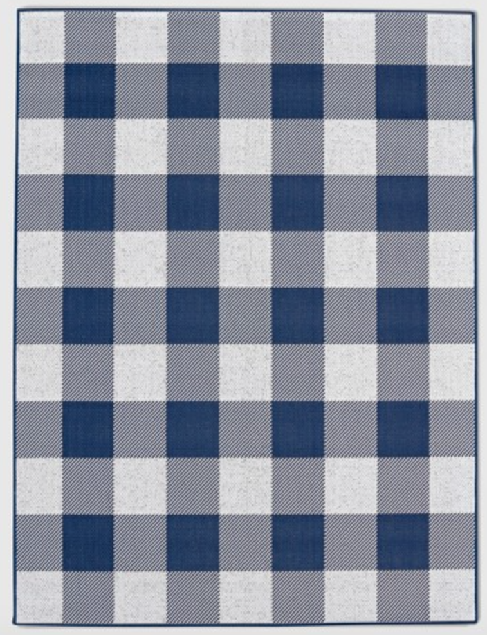 Buffalo Plaid in/outdoor rug - Since buying this, I have purchased a few more. They are so cute and brighten up simple spaces like the laundry room. It wasn't in my house for a hour before the kids got paint on it. To my surprise, it came right out with a little water. Amazing product ~ And it comes in other colors.