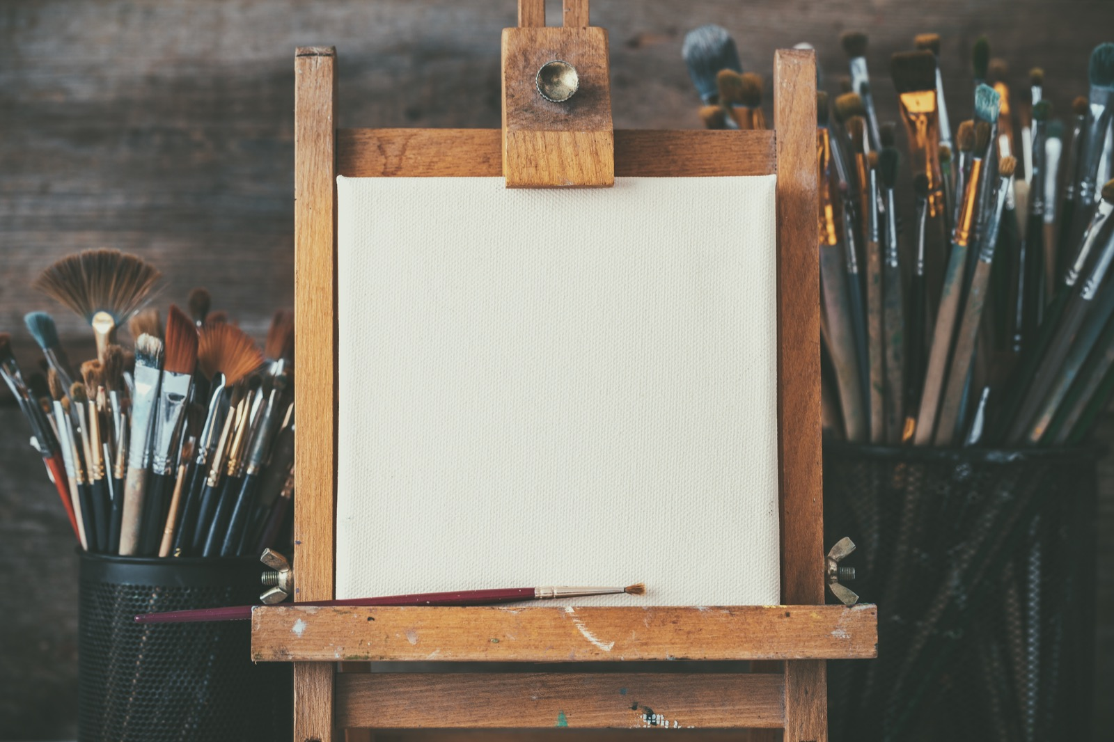 Artistic-equipment-in-a-artist-studio-empty-artist-canvas-on-wooden-easel-and-paint-brushes-Retro-toned-photo.-668060762_5196x3464_Web.jpeg