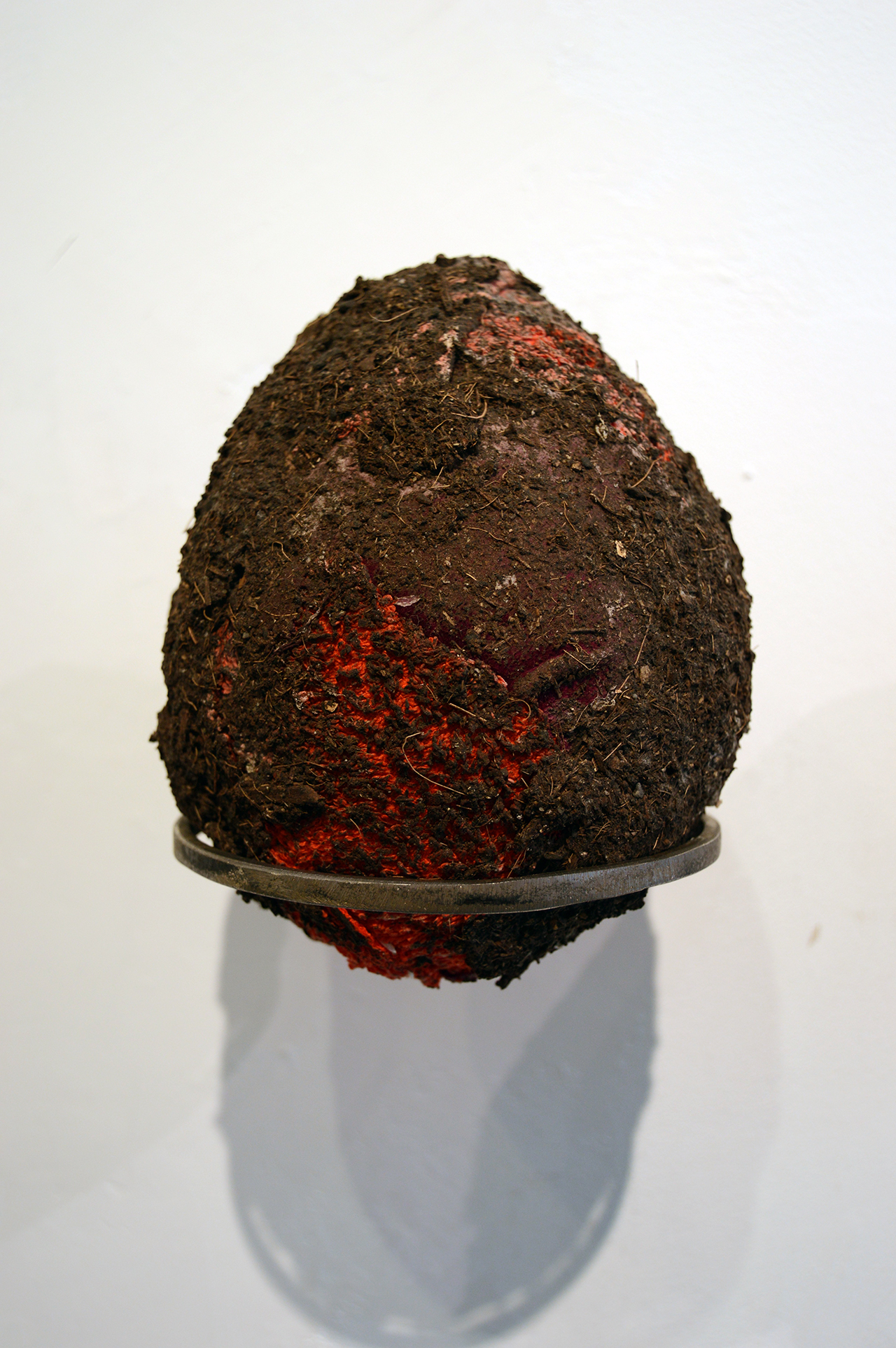 "Pedro Wirz  Ovo por Olho - ""An Egg for an Eye"" (Humus)  Humus, old fabric, latex acrylic medium (metal ring)  16.5 cm x 13 cm x 17 cm ( 6.5 in x 5 in x 6.7 in )  2018"