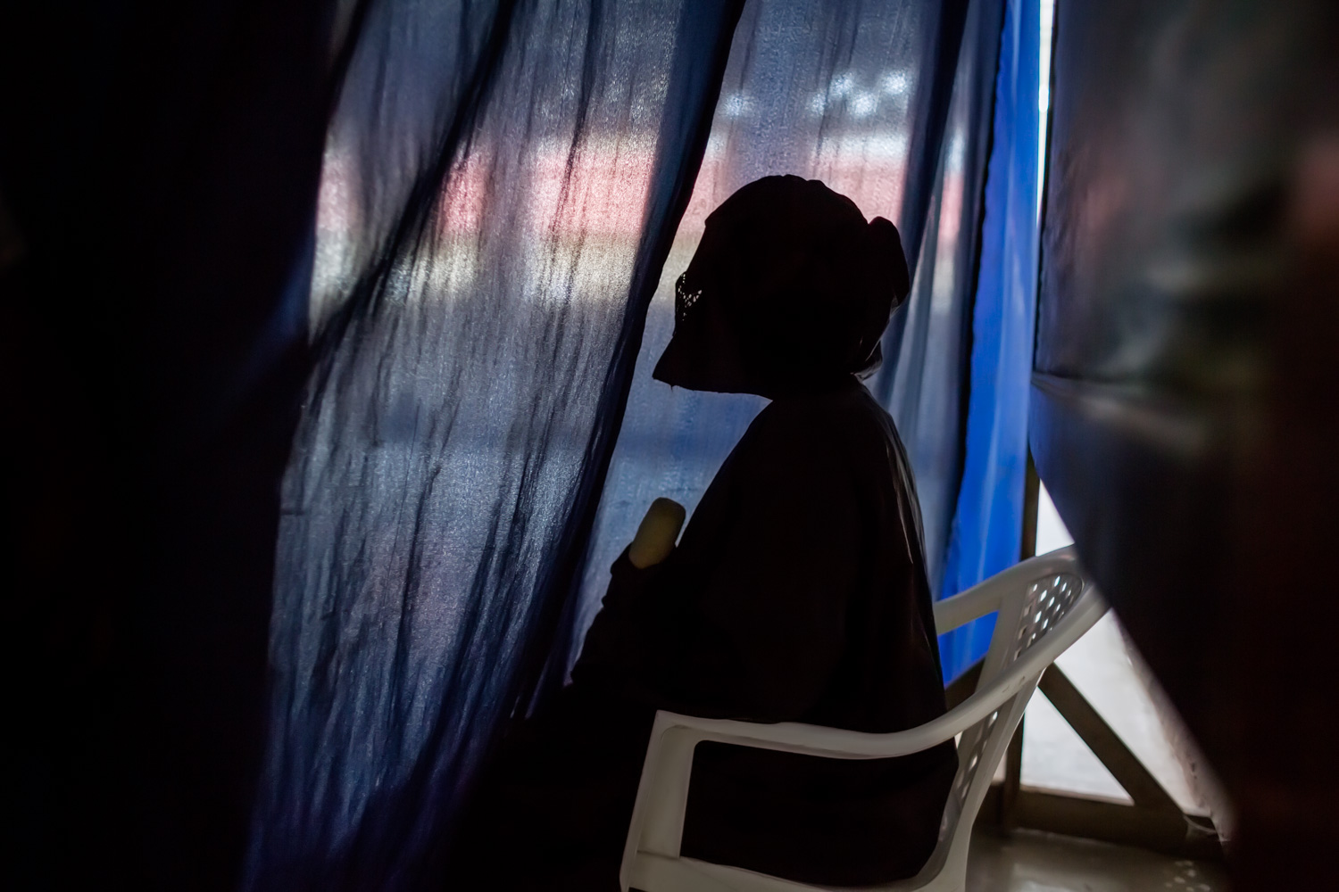 A veiled rape survivor testified in court behind a curtain to further shield her from the eyes of those she accused. Special care is taken to provide rape survivors with disguises, curtains, veils, whatever they may need to feel secure when giving their testimony. The women are referred to by numbers instead of by name to maintain their anonymity.