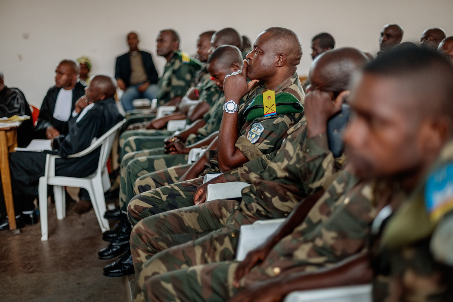 All but four of the 37 soldiers accused of rape sat in the trial room. The missing four were still on active duty in northern DRC. 25 of the accused were lower-ranked soldiers, while twelve were officers in charge of those soldiers' units. At a trial in nearby Mupoke in 2013, only one soldier stood accused of rape. The others fled before the trial took place.