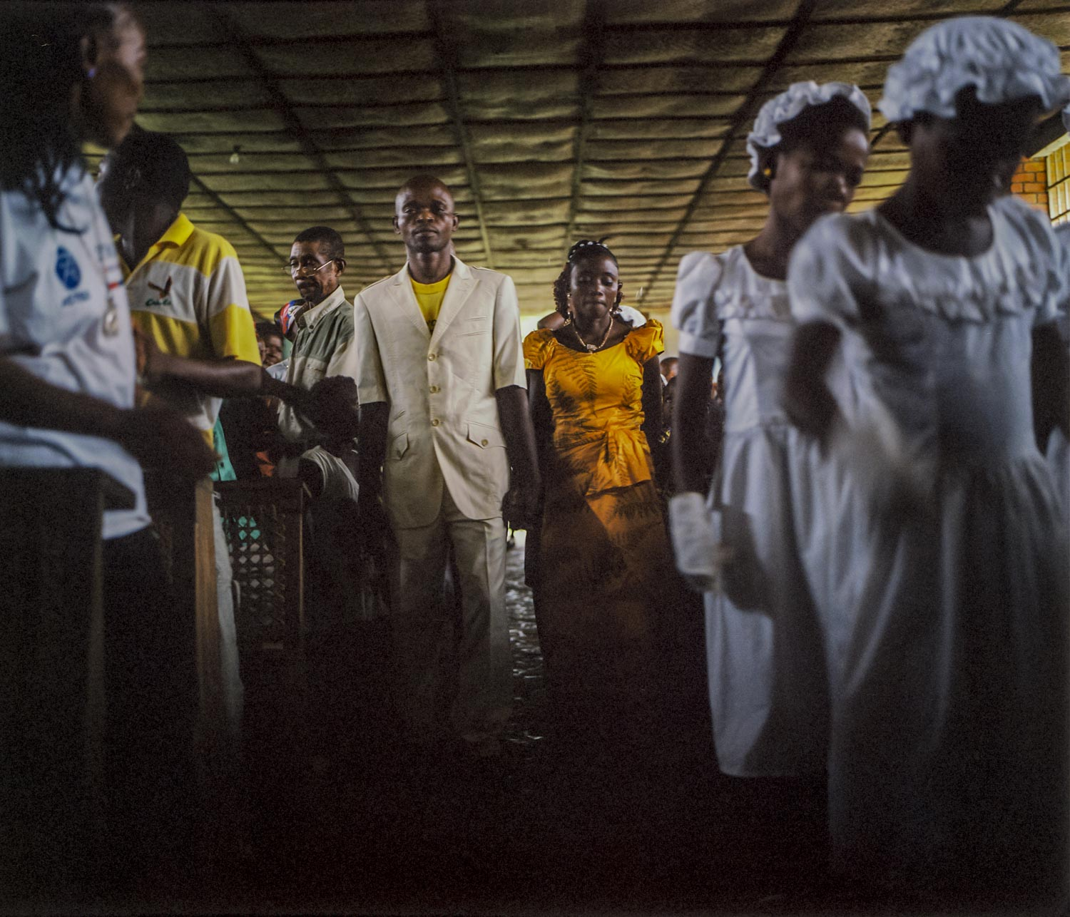 In a Catholic church, a couple walks down the aisle during their marriage ceremony. A normal sight in other parts of the world, in Lulingu, this offers a testament to the sense of relative security felt by villagers.Dec. 29, 2013. Lulingu, South Kivu, Democratic Republic of the Congo.
