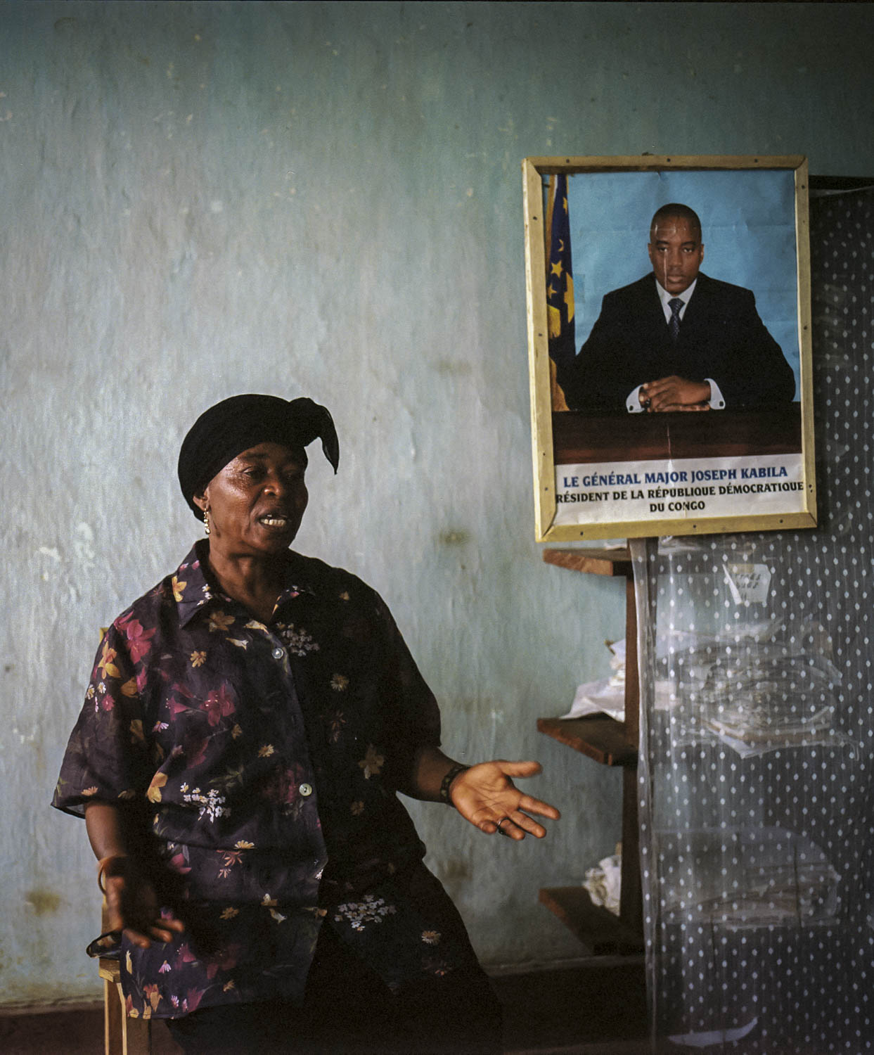 Seated in her office, Henriette Useni Kabake, Lulingu's government Administrator, explains her position vis-a-vis the Raia Mutomboki. Herself a victim of the abuses of both the Interahamwe and the Armed Forces of the DRC, she says she is happy with the security the RM have brought to the area. Dec., 2013. Lulingu, South Kivu, Democratic Republic of the Congo.