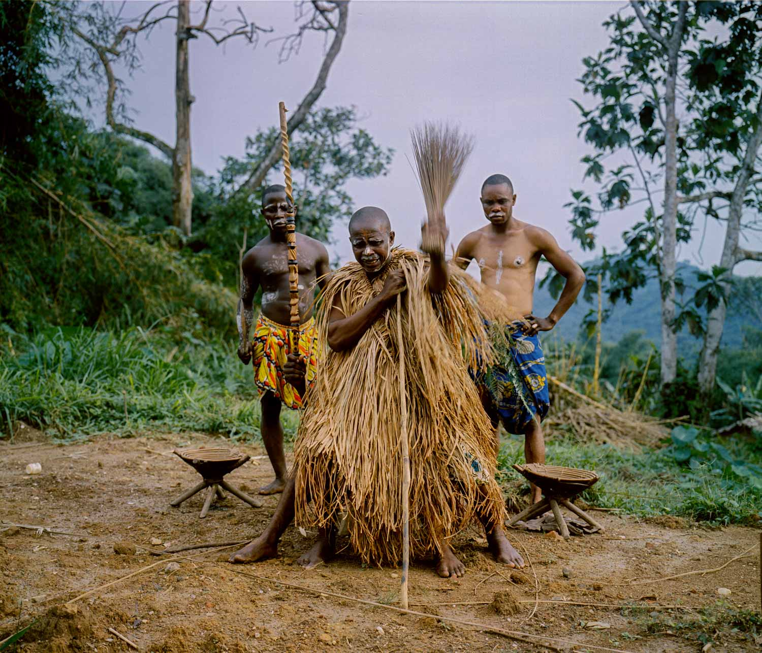 A traditional ceremony takes place outside the home of Lulingu's King Asani Keka Mbezi.  The Raia Mutomboki's members are ethnically part of the Lega tribe, known for its intact traditions and witchcraft.  The arrival of colonial Belgian powers and its western missionaries wiped out most traditions in Congo.  The remoteness of the Lega peoples, however, who inhabit the jungle areas in the east, allowed for the survival of their traditions. Dec., 2013. Lulingu, South Kivu, Democratic Republic of the Congo.