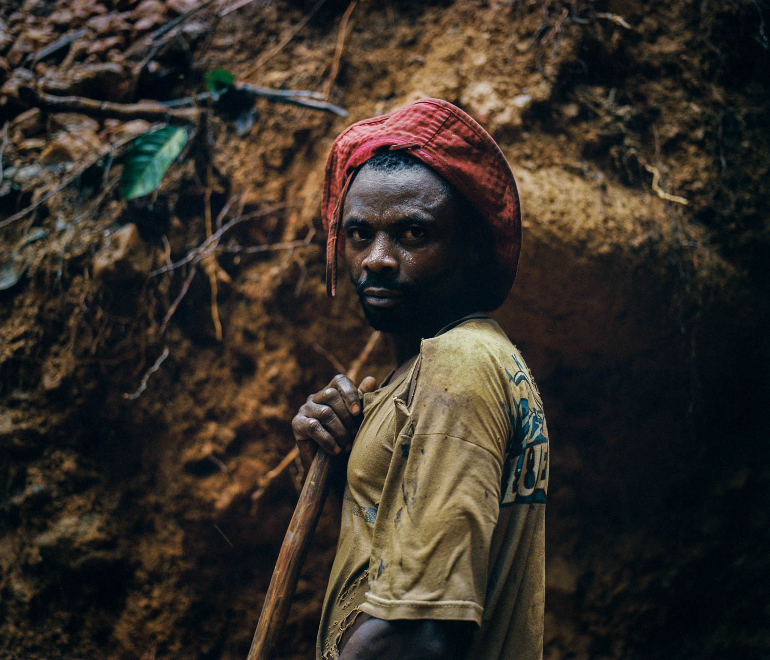 Migrants from the Bashi tribe of Bukavu region provide labor for the mines in territory controlled by the Raia Mutomboki. The Rega tribe, which make up the RM, are able to play supervisory roles due to their unique technical knowledge on the mining industry gained from laboring under the Belgian colonial enterprises of the past. Dec., 2013. South Kivu, Democratic Republic of the Congo.