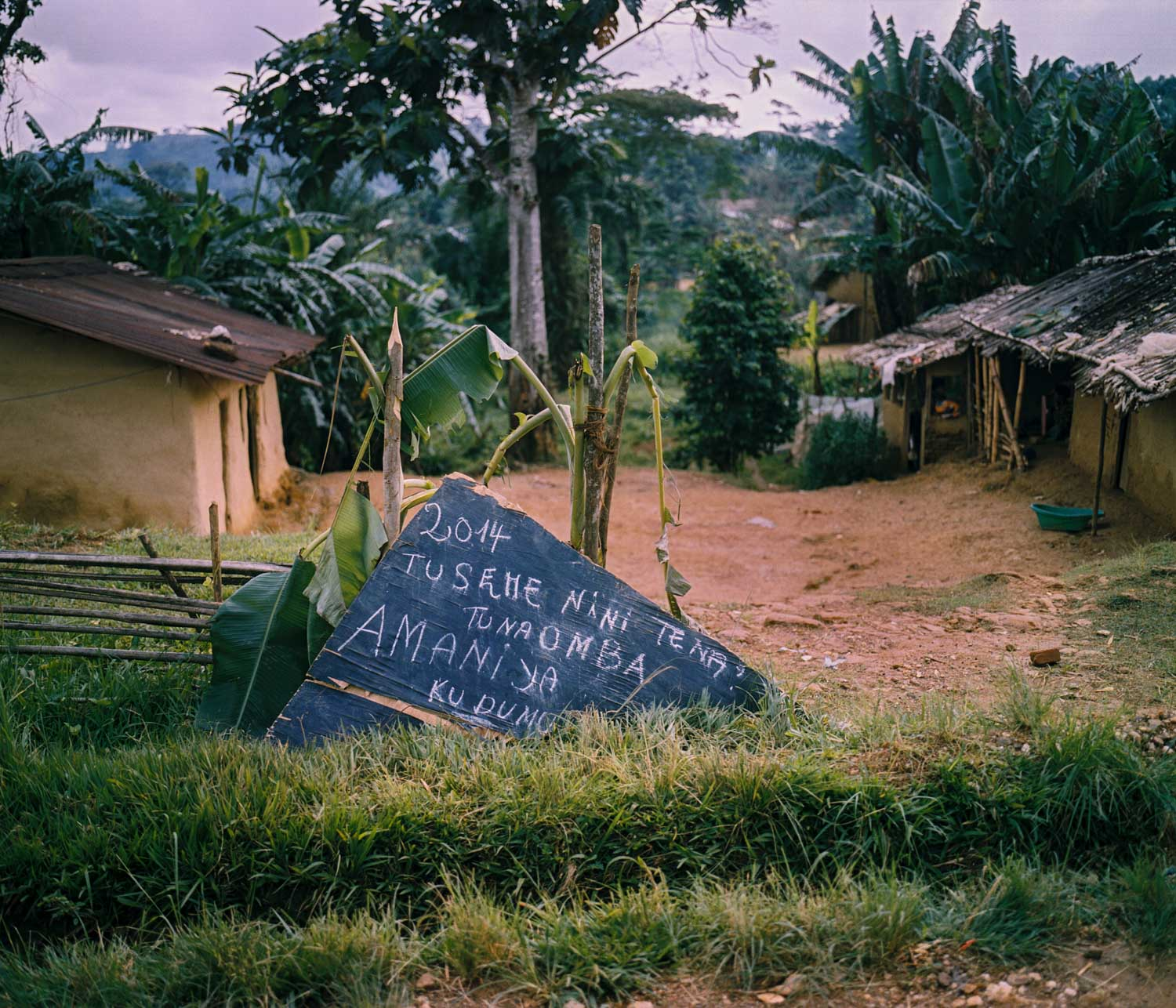 """On New Year's Eve, a roadside sign reads, """"2014, what shall we say again? We ask for lasting peace.""""Dec. 31, 2013. Lulingu, South Kivu, Democratic Republic of the Congo."""