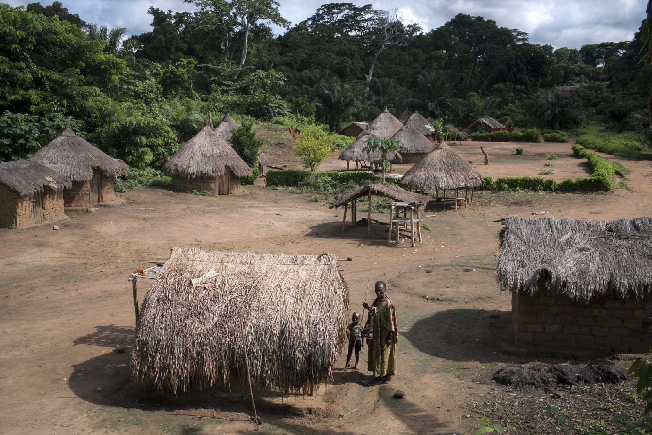 A woman and child stand outside their home in the village of Nzeret, the epicenter of a measles epidemic that spread through this remote area of northern Democratic Republic of the Congo (DRC) in early 2016. In response, MSF carried out a 5-day measles vaccination campaign. MSF had named measles among the top five epidemics that could erupt or worsen in 2016. DRC has the fifth highest under-five mortality rate in the world, with an estimated 465,000 children losing their life to preventable diseases every year. Nzeret, Bas-Uele province, Democratic Republic of the Congo. May 27, 2016