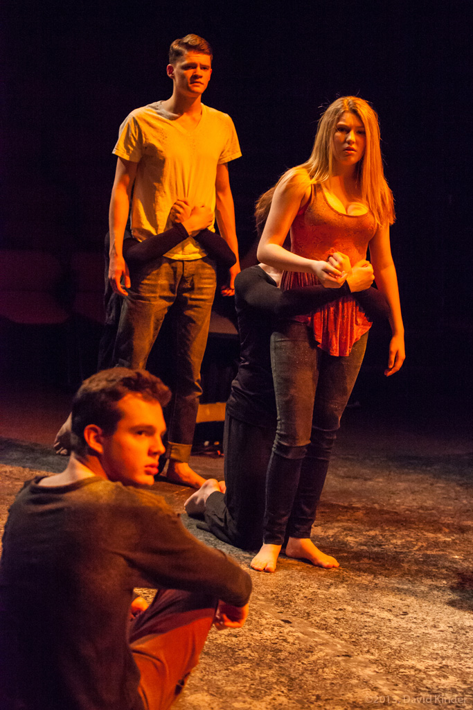Christopher James as Saul, Jacob Orr as Davin, and Amber Kiara Mitchell as Vea with members of The Fire in What Are We Doing Here?