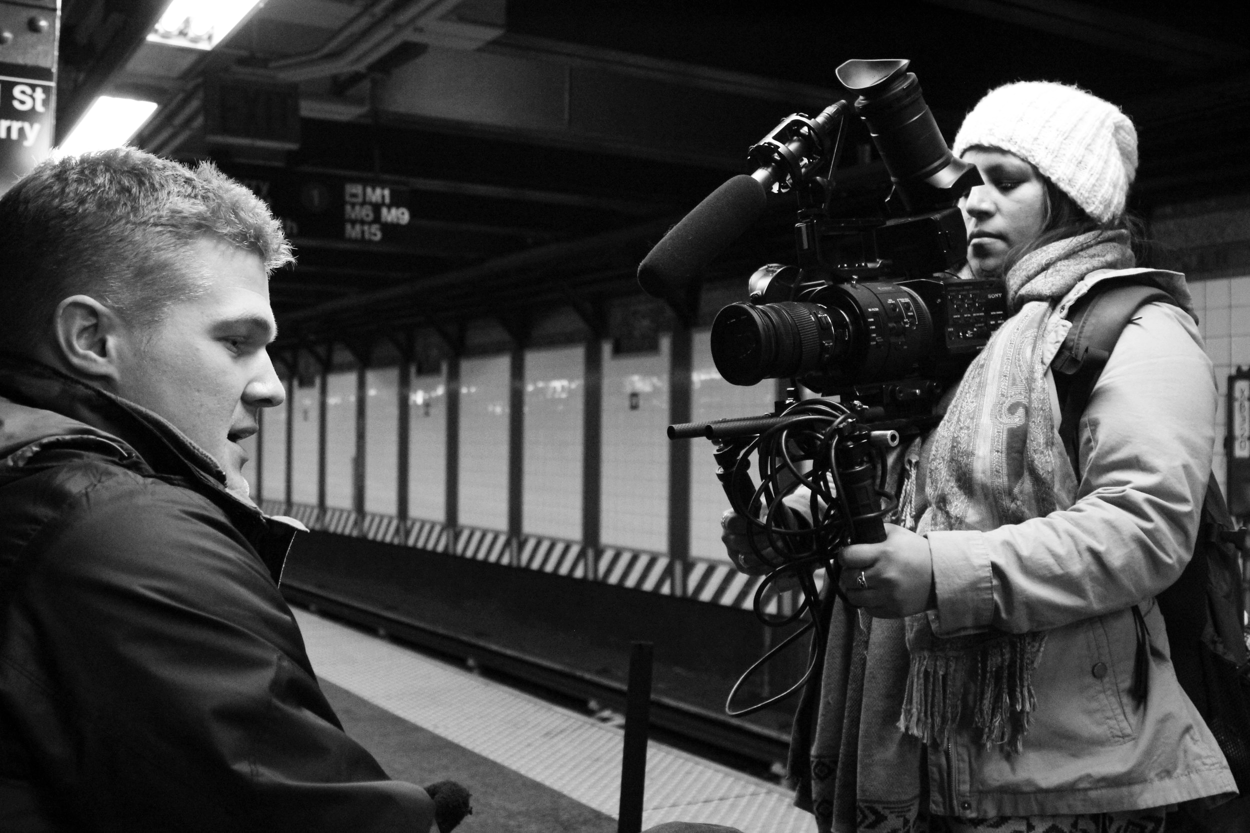 On set in New York City with DP Thomas Shannon, turning the lens to interview a member of the family on their idea of a lottery system.
