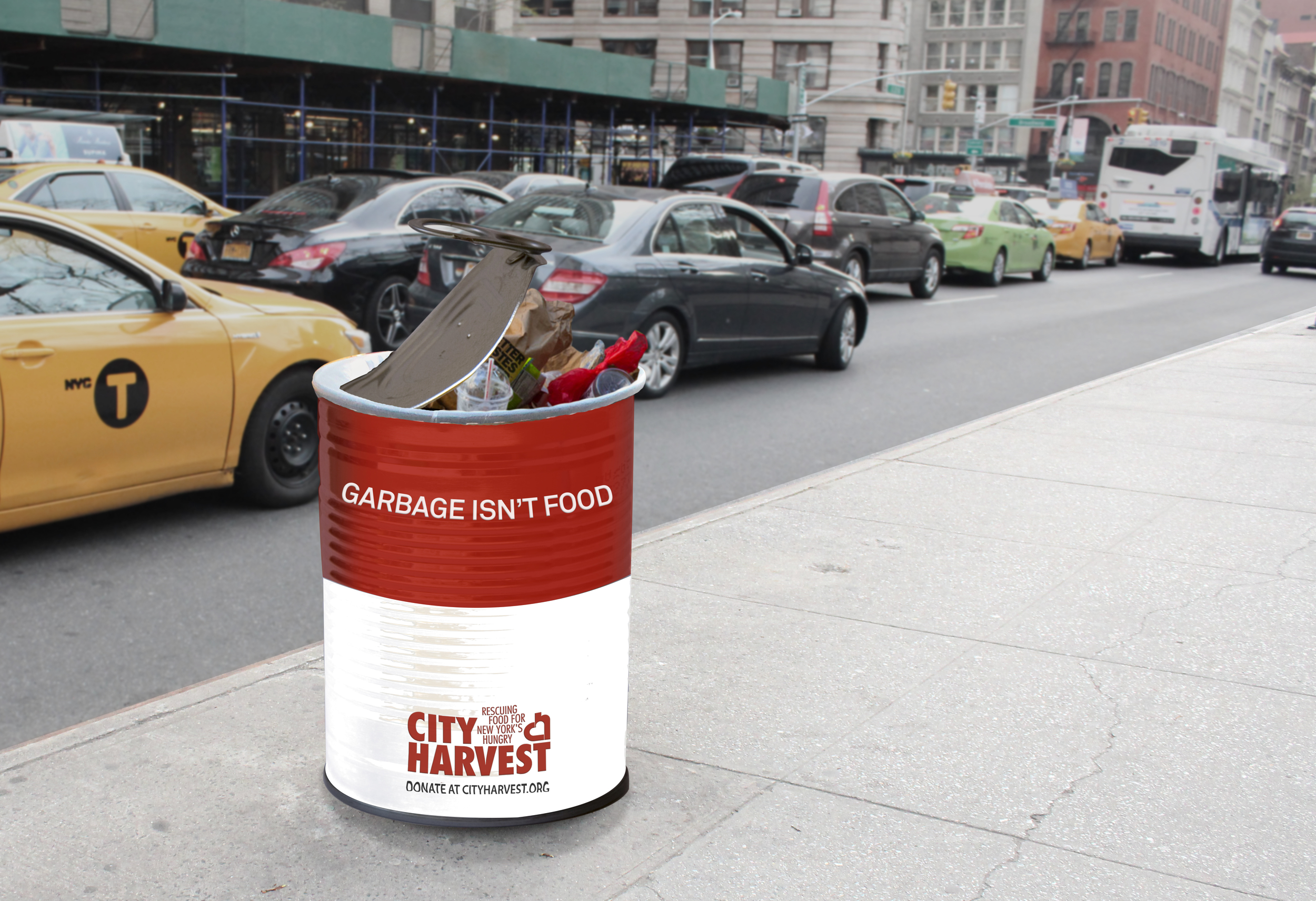 To promote the importance of City Harvest's mission and to encourage donations, garbage cans around the city are made to look like food cans, showing where some of the city's poorest residents are forced to go for food.