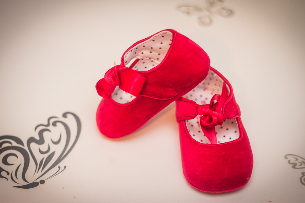 Red Baby Shoes by Captured By Katie Photography, Tacoma Maternity Photographer