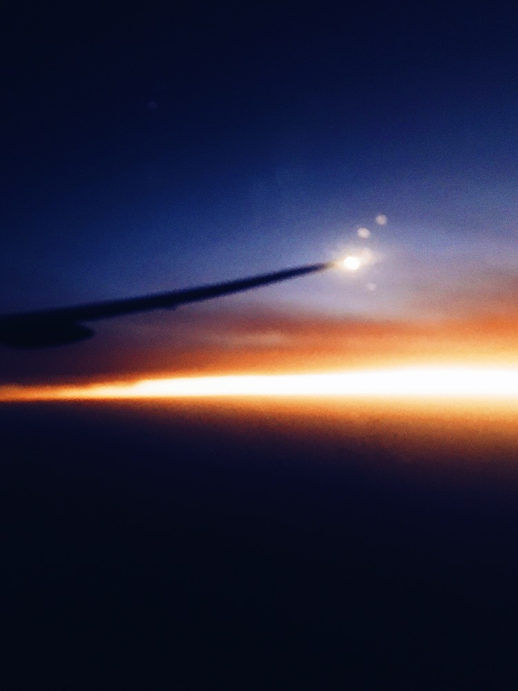 While everyone else is asleep, I snuck a photo of the sunrise over Africa
