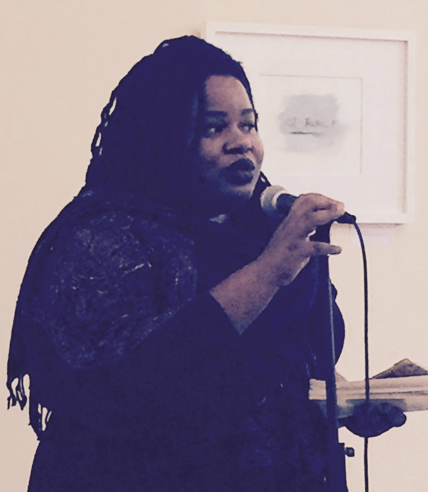 Reading from  patient.  at Richmond Public Library, 2016. Photo Credit: Rania K. Swies