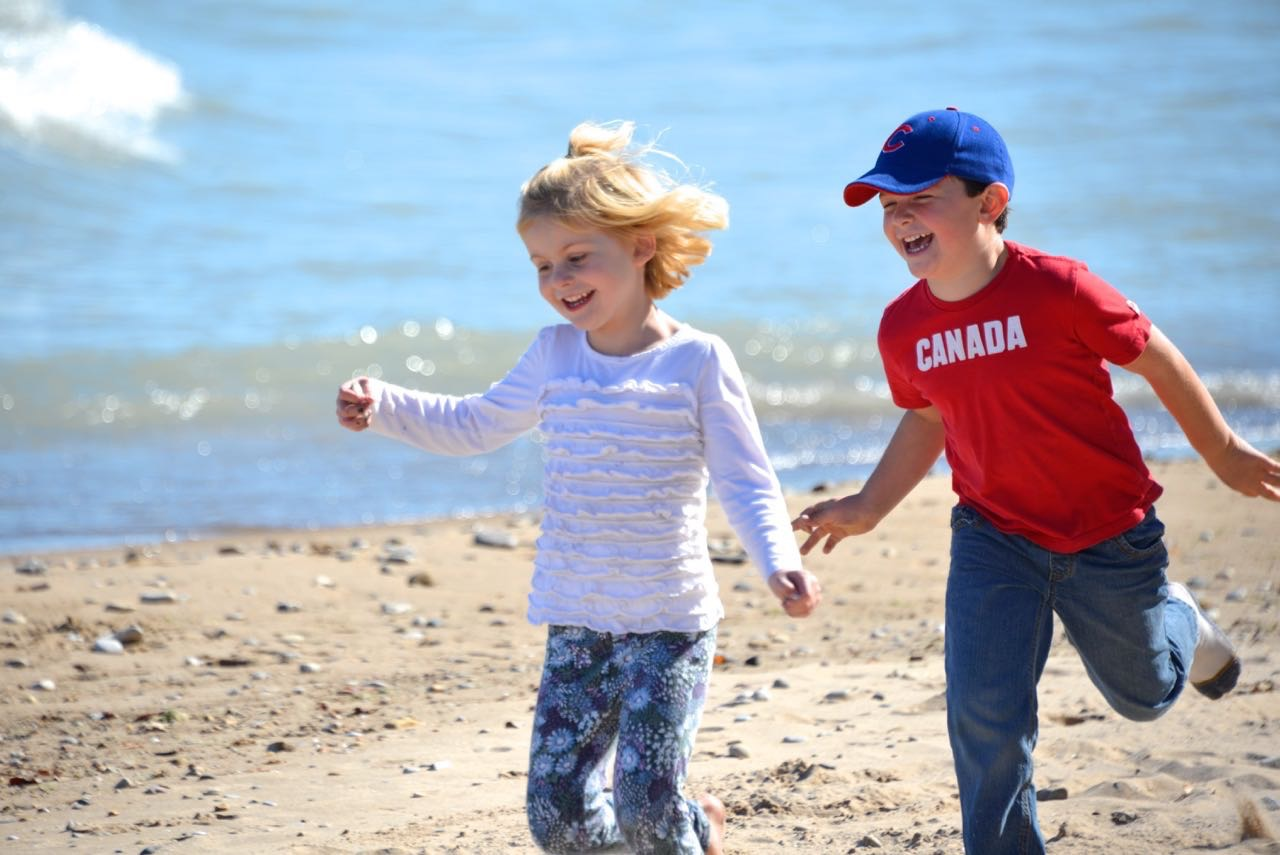 Two kids running on beach .jpg
