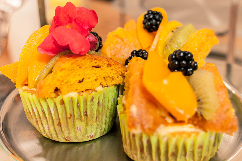 Vegan cupcakes...mango and lime with fresh fruit and edible flowers