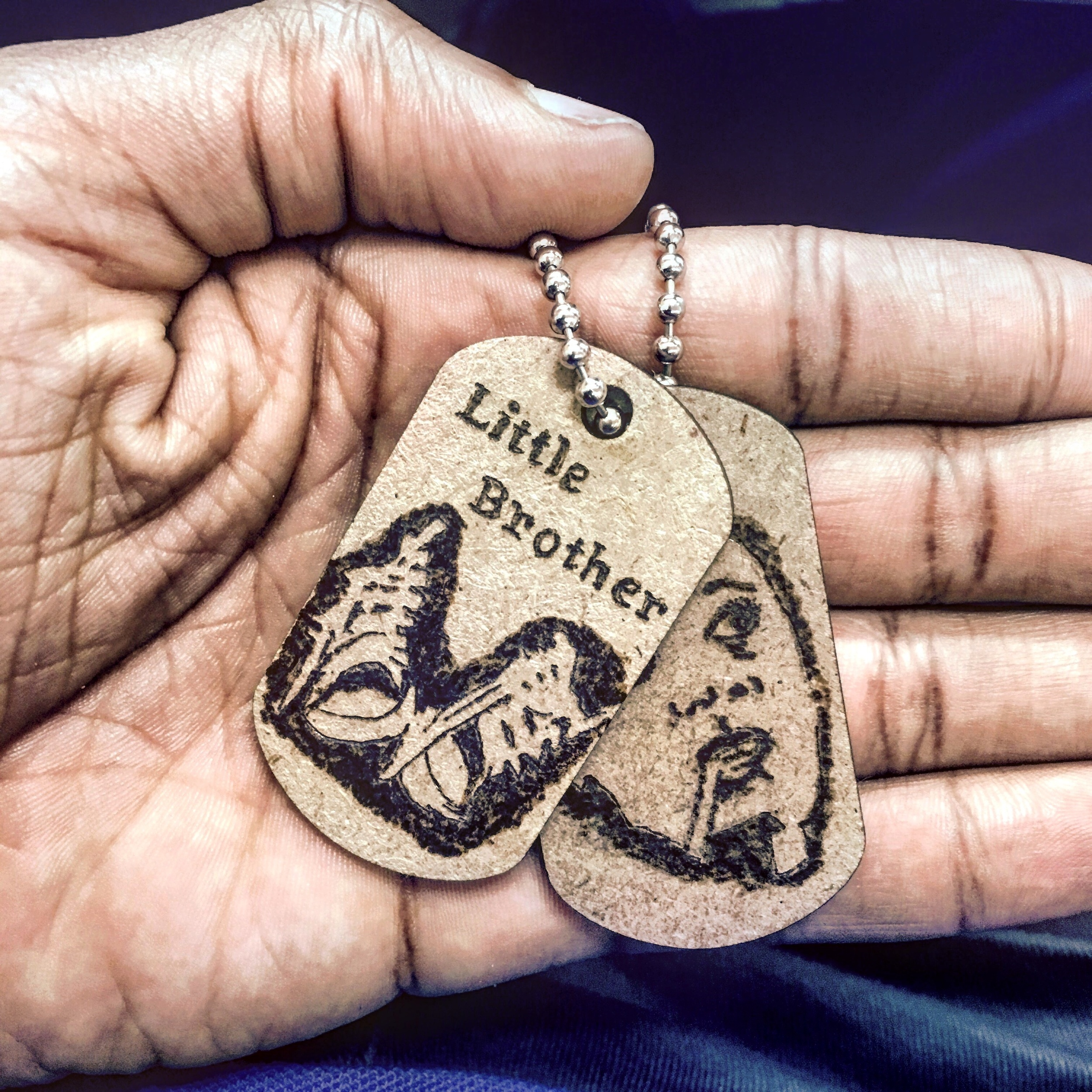 Amb Ambrose WB Hand Holds Dogtags.jpg
