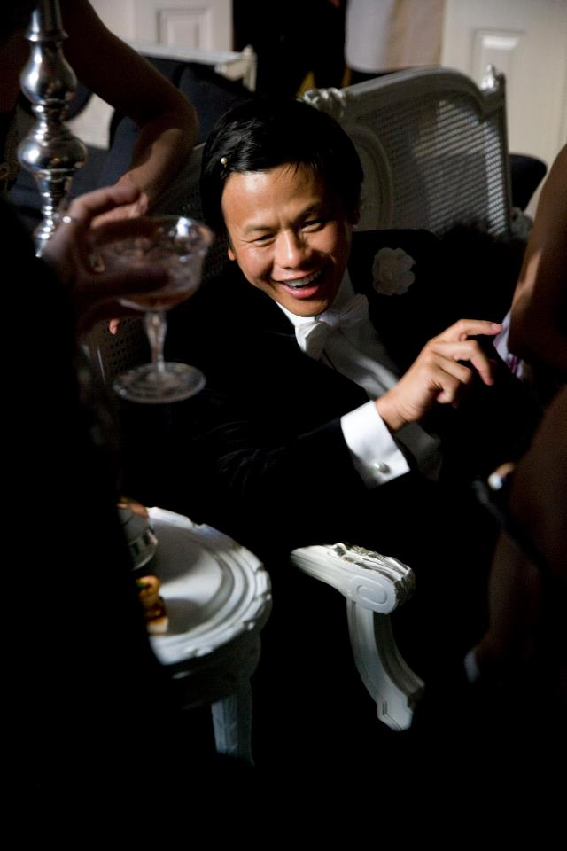 Zang Toi entertains guests in his home.