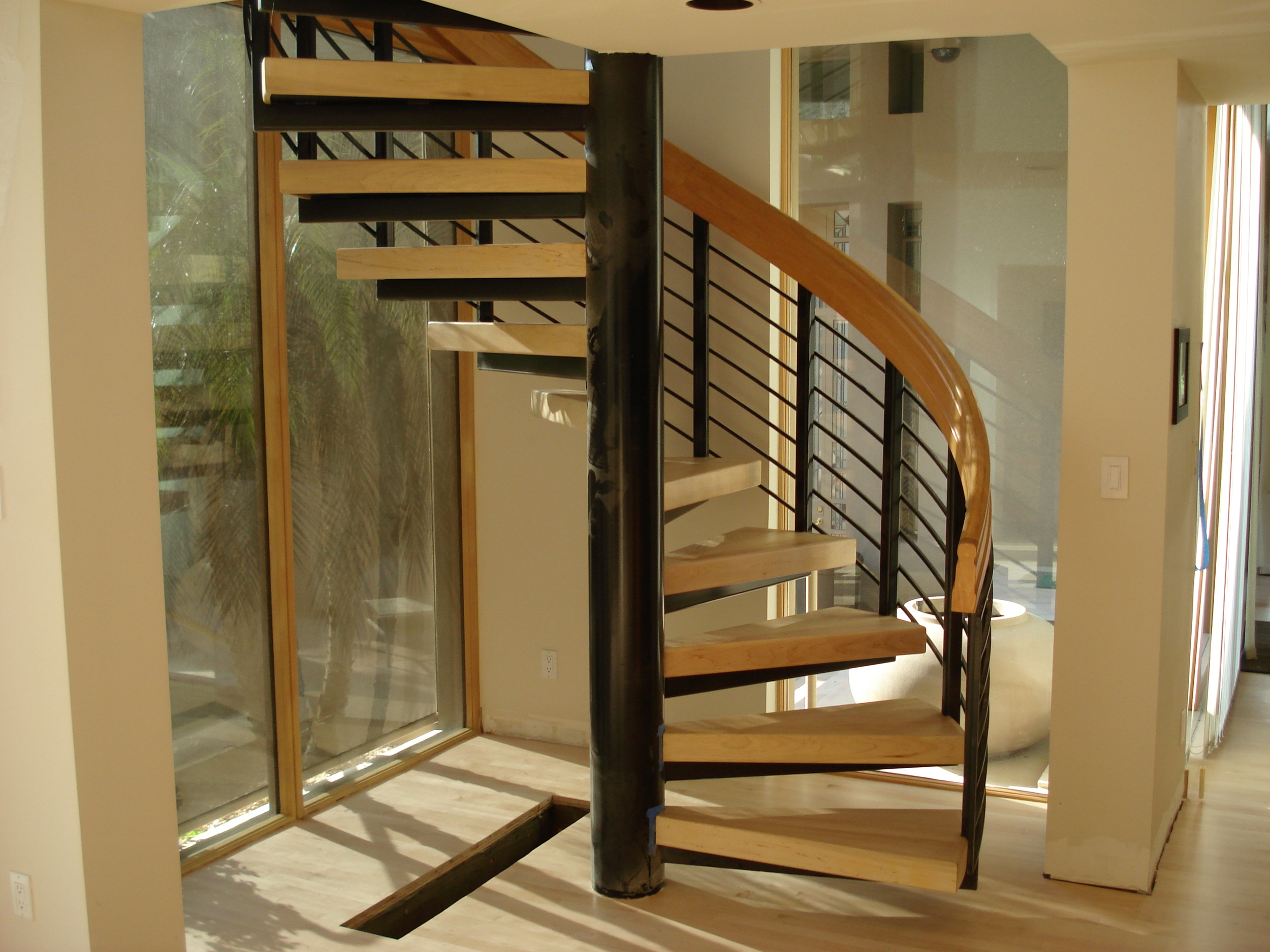 Spiral staircase with maple treads