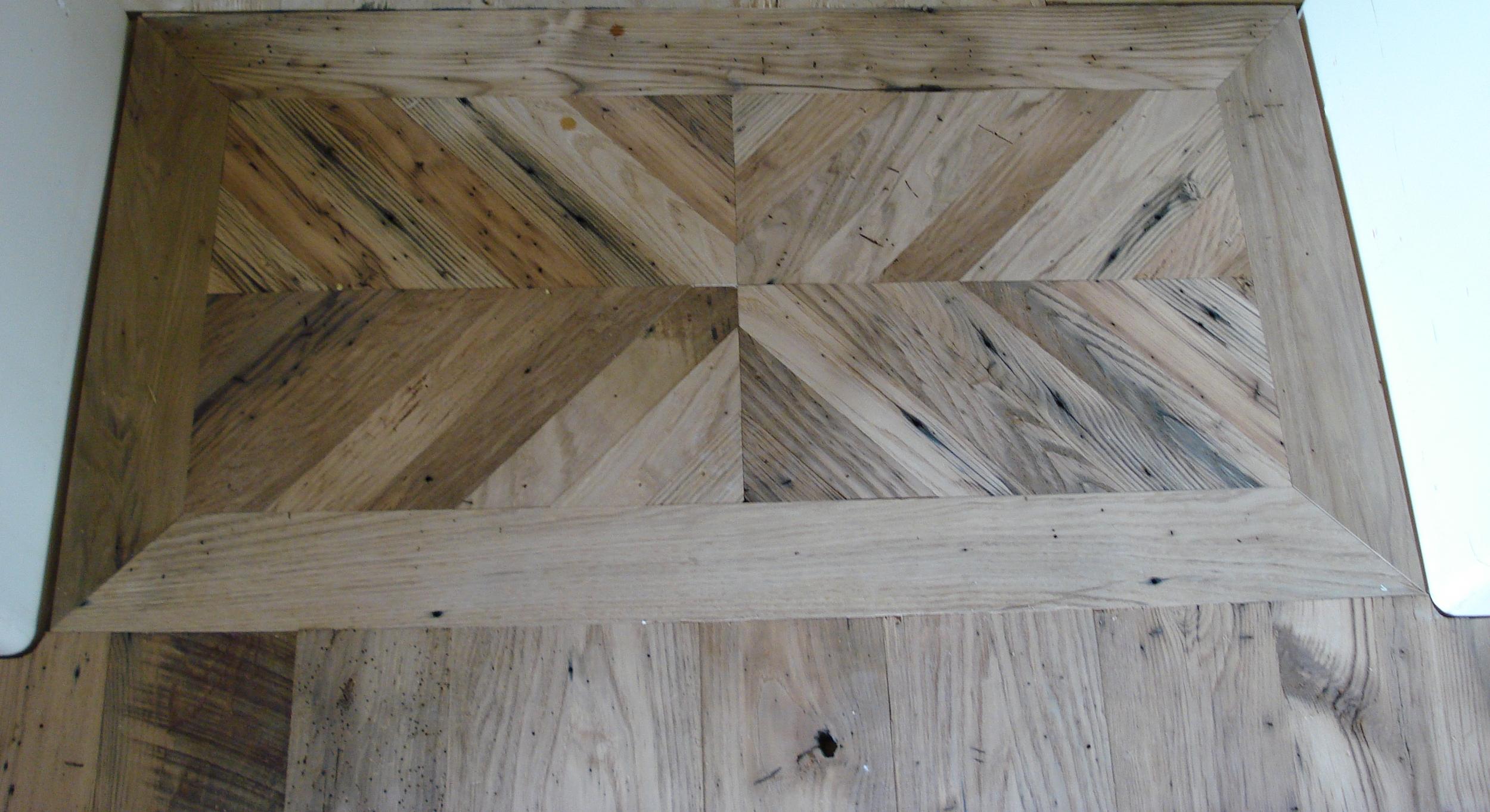 Starburst pattern wood flooring transition