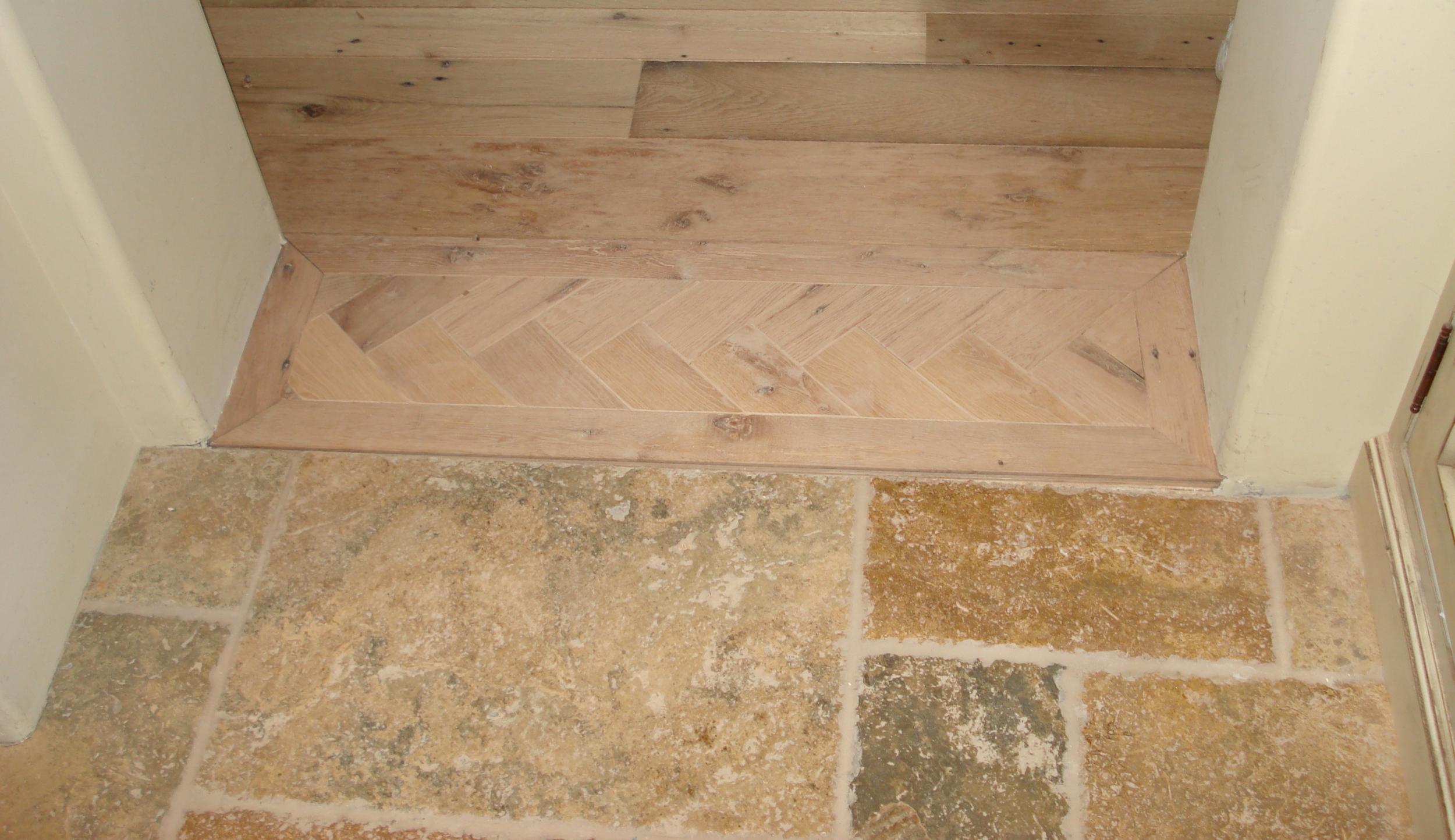 Herringbone pattern flooring transition