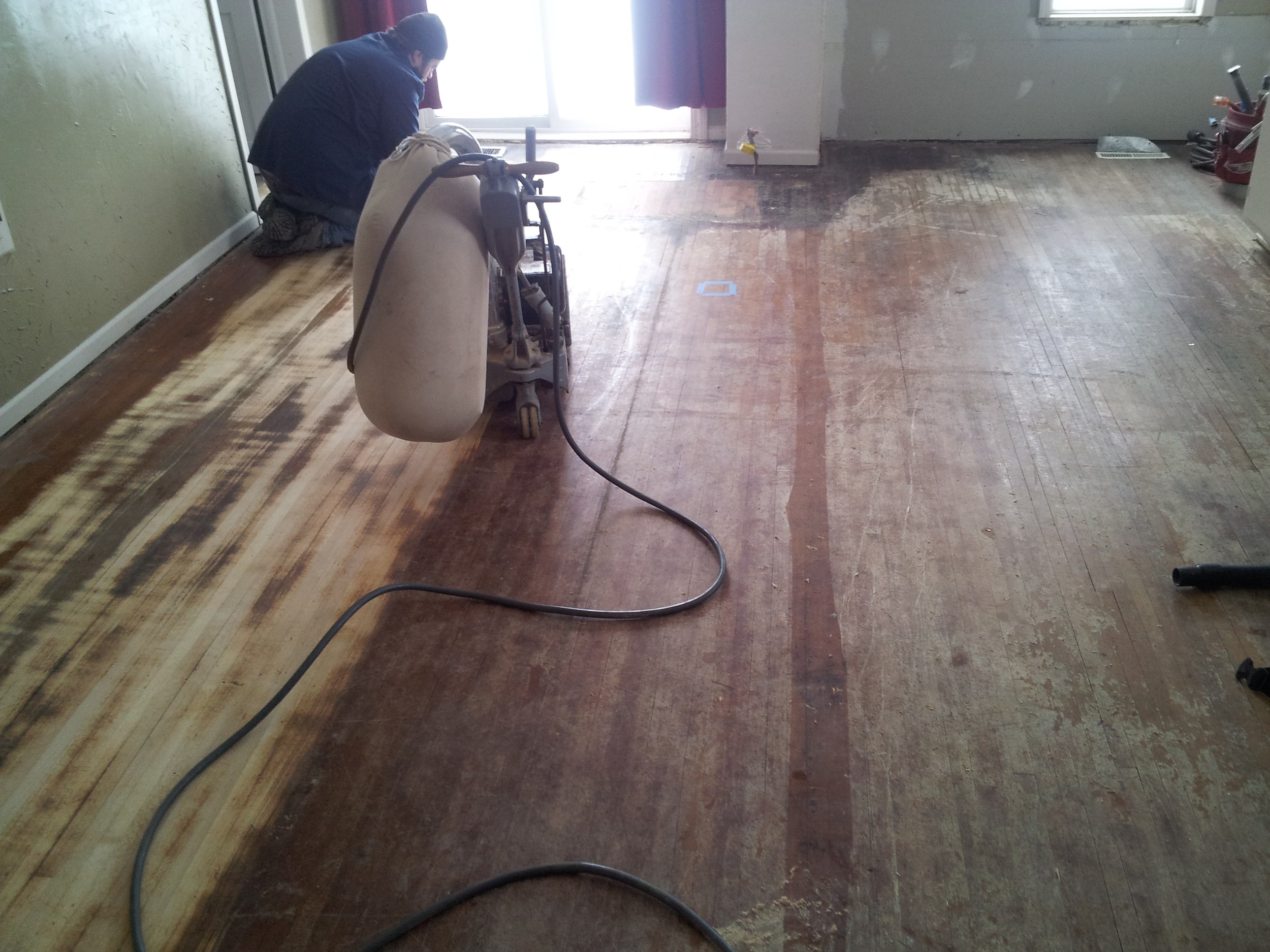 Sanding an old farmhouse hardwood floor. The process makes quite a difference!