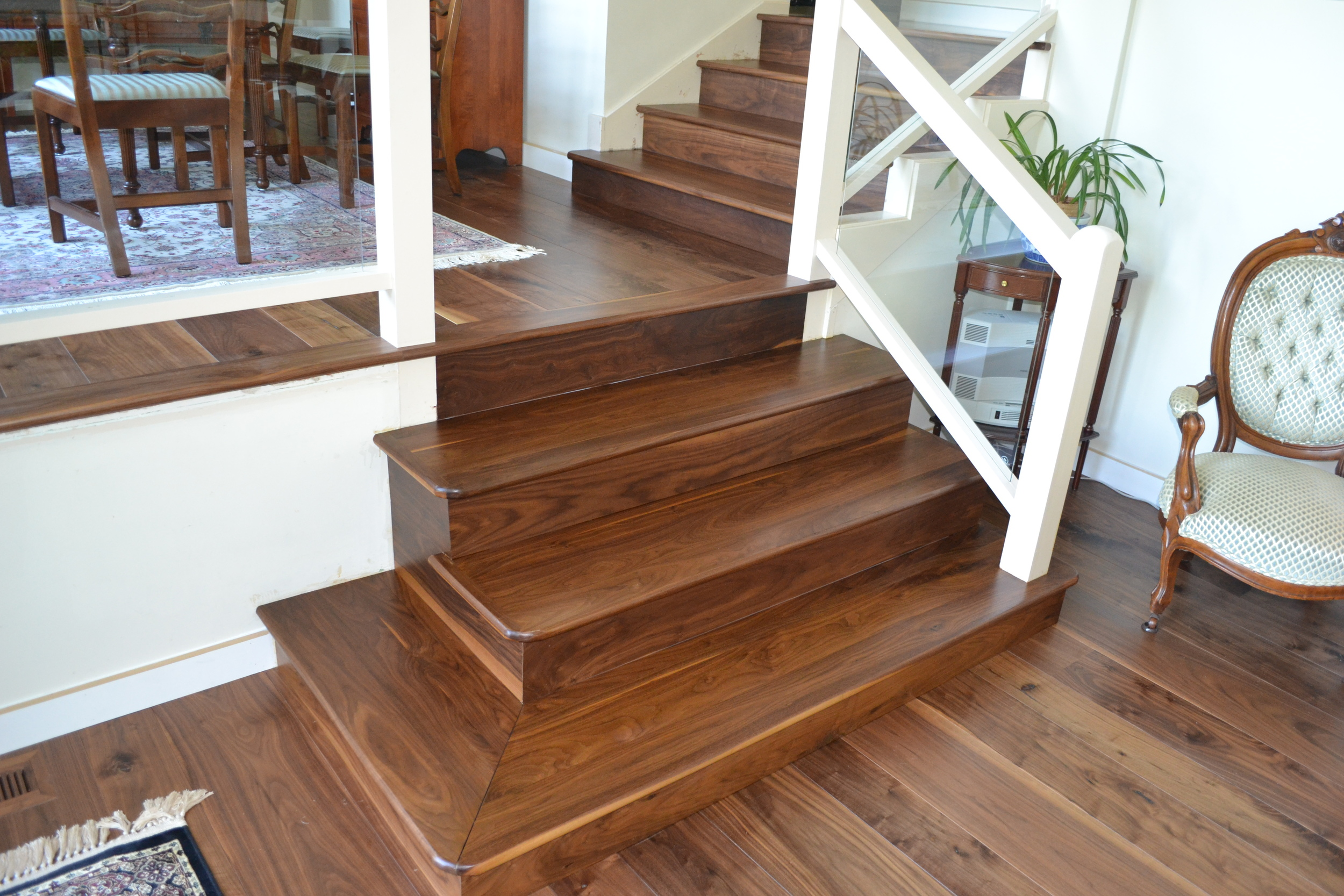 "Custom walnut staircase installed in Edina and a 4"" paint grade base with a 1/2"" round over."