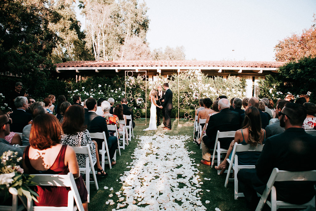 Carpet of white petals for the aisle