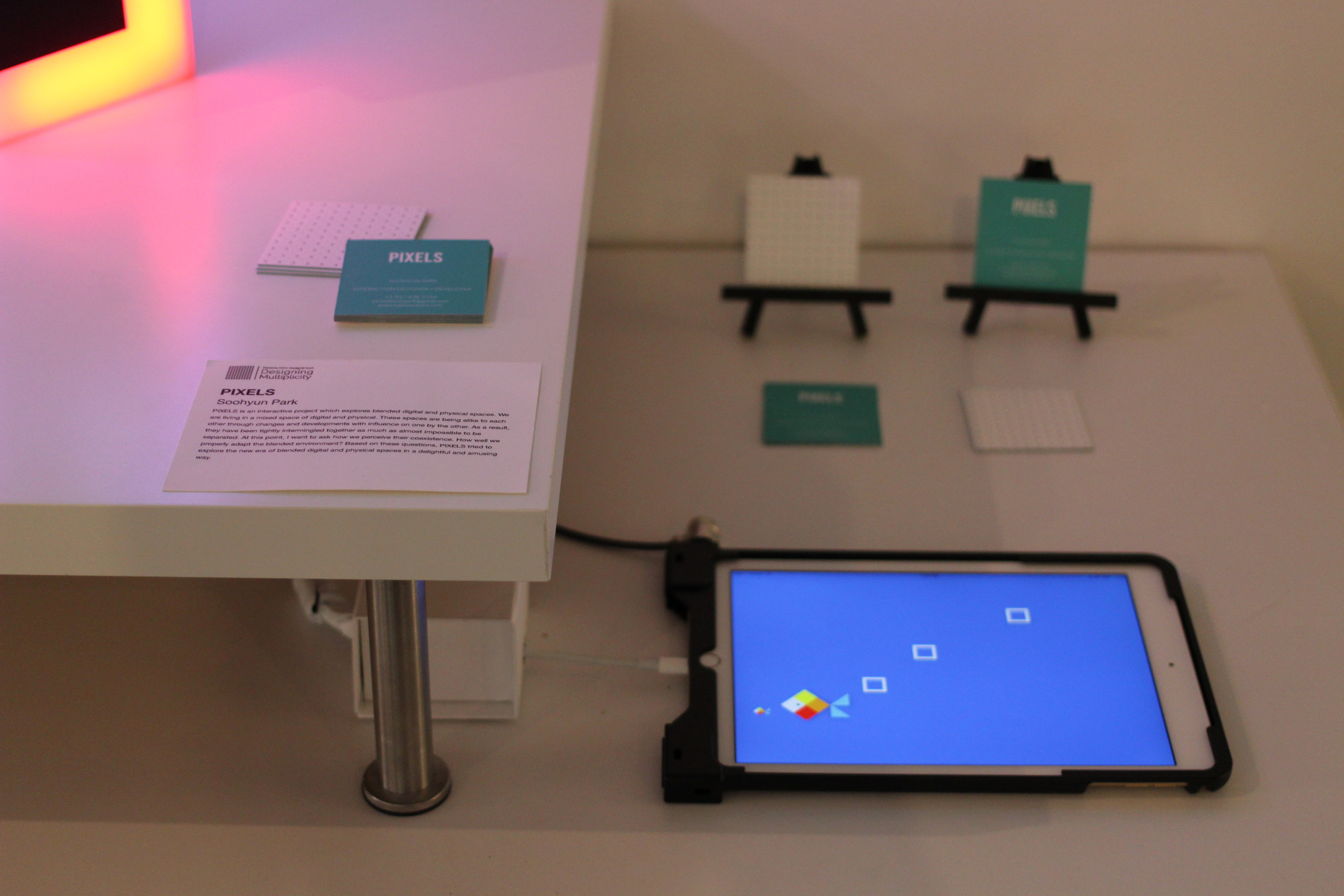 """Users can  connect to up to 4 PIXELS objects  with the app """"PIXELS"""" and see multiple square box appears on the screen. Each one box correlates to specific connected object and show the same color of pixel.  UX Example 01 : (single user)play with dragging boxes on the screen to catch the fishes. challenging to change the color of light object as much as they can.   UX Example 02: (multiple  u  ser)  a person drags the boxes on the screen and place the boxes in certain order or shape. the other person challenges to find out which PIXELS object connected to which white box on the screen and place the object in a same order of shape that the other made."""