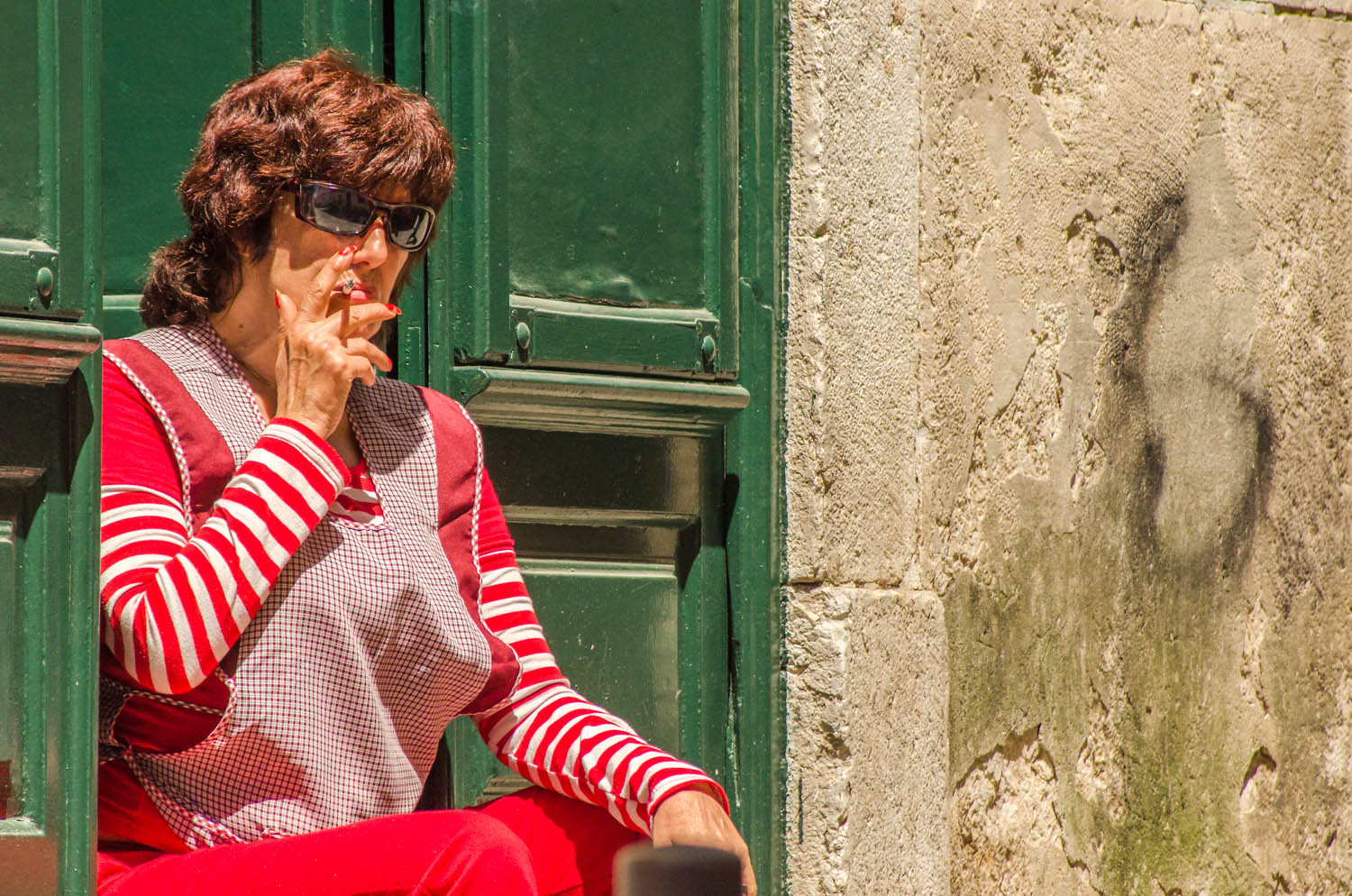 Whenever I take the photo tour to Bairro Alto, Lisbon, I've always found an interesting character. The face alone is very interesting with the glasses and the cigarette but how can you resist the red stripes against the green door. Why didn't I shoot vertically? good question, I don't know why.
