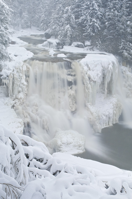 """Blackwater Falls in Winter"" - Blackwater Falls iced up and covered in snow during a winter snowstorm. Blackwater Falls State Park, West Virginia."