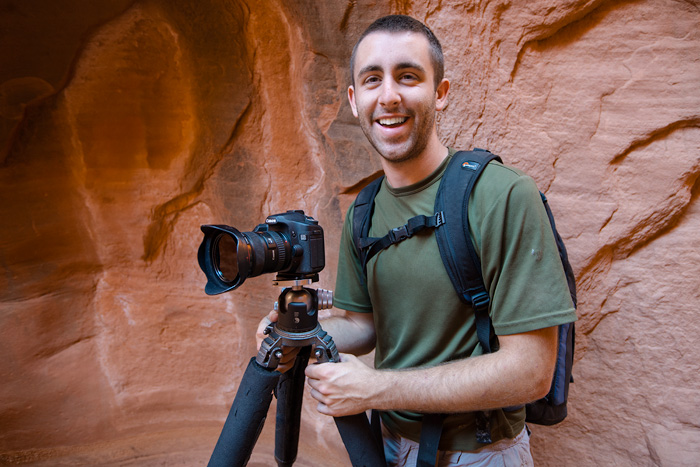 Chris Kayler photographing deep within a slot canyon in Utah.