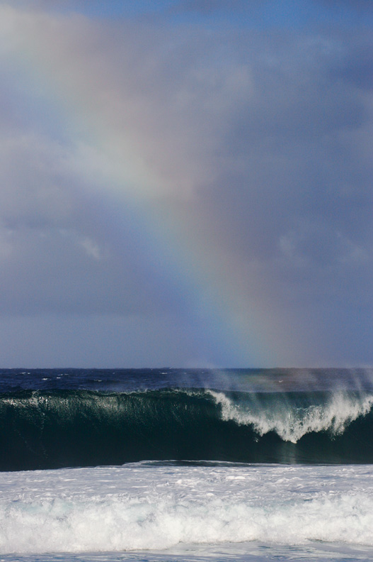 """Under the Rainbow"" - A rainbow over the famous surfbreak, Pipeline. North Shore, Oahu, Hawaii."