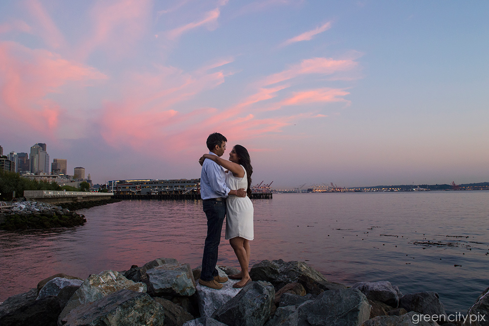 Perfect moment on the rocks. Thank you, Nature, for providing the pink and purple sky for this couple's photo shoot! I love their embrace, and how the colors are reflected off the water.