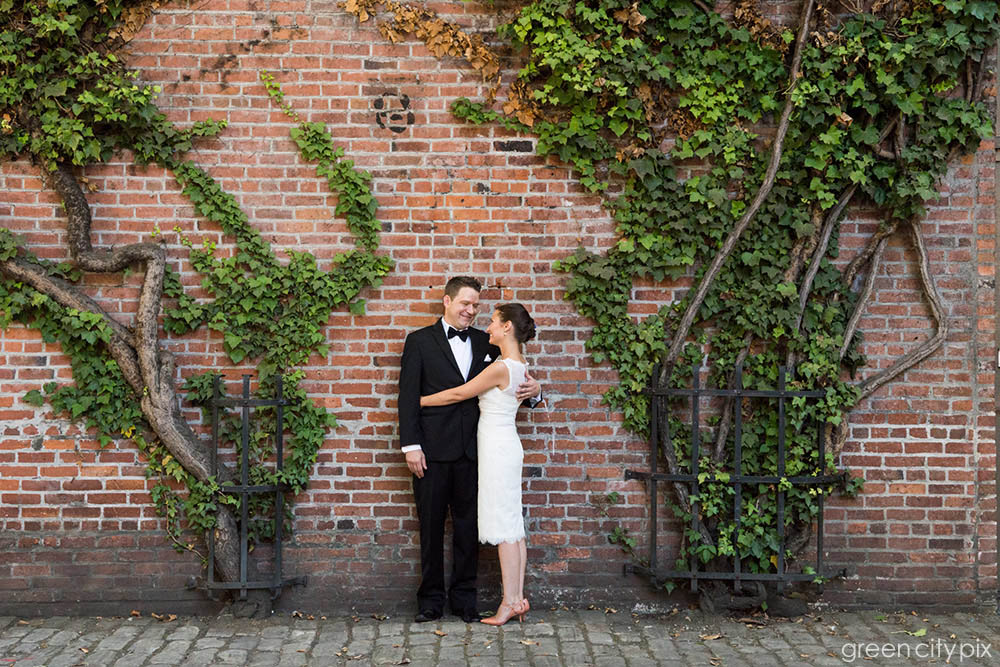 This cool ivy-covered wall near Occidental Park provides a natural frame for the happy couple.