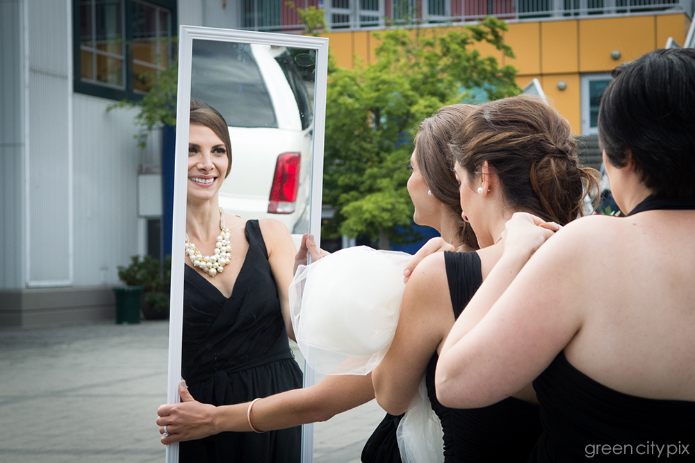 Mirror, mirror: The bridal party stepped out of their limo carrying this big wall mirror.  They knew they were being funny, and didn't mind me taking a photo of them primping.